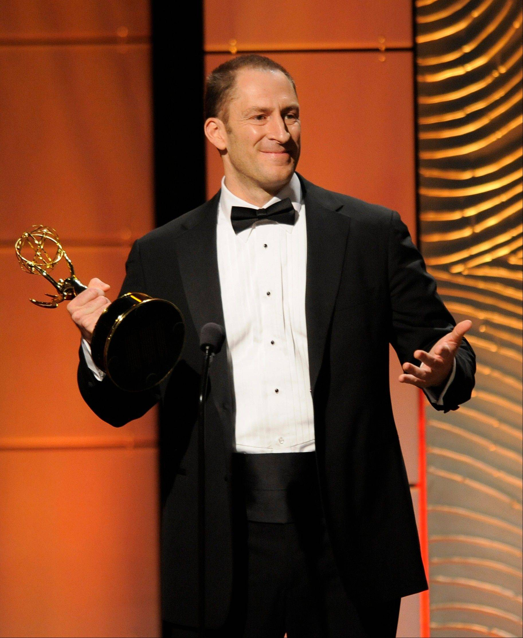 "Ben Bailey accepts the award for outstanding game show host for ""Cash Cab"" at the 40th Annual Daytime Emmy Awards on Sunday, June 16, 2013, in Beverly Hills, Calif."