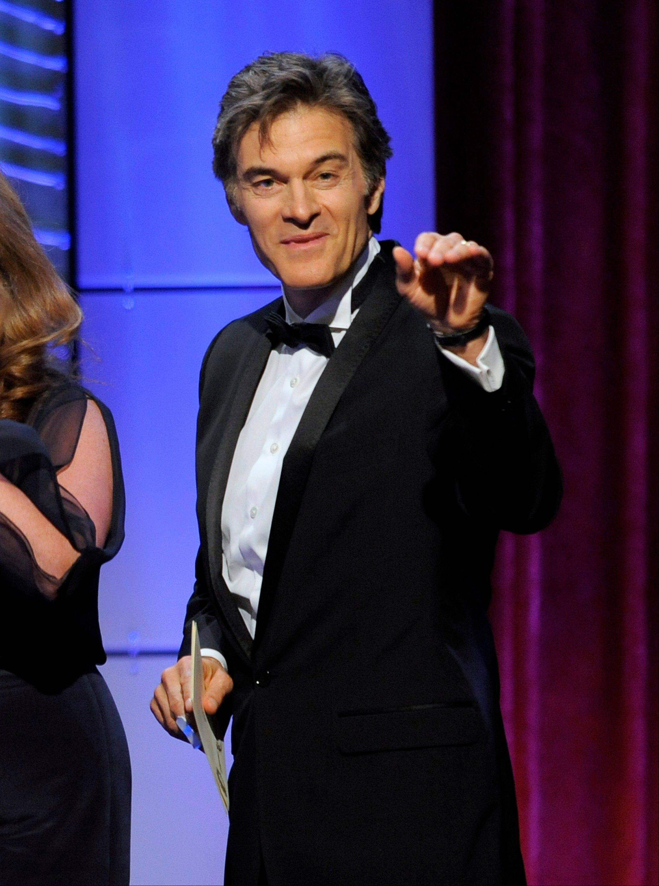 "Mehmet Oz, aka Dr. Oz, accepts the award for outstanding talk show: informative for ""The Dr. Oz Show"" at the 40th Annual Daytime Emmy Awards on Sunday, June 16, 2013, in Beverly Hills, Calif."