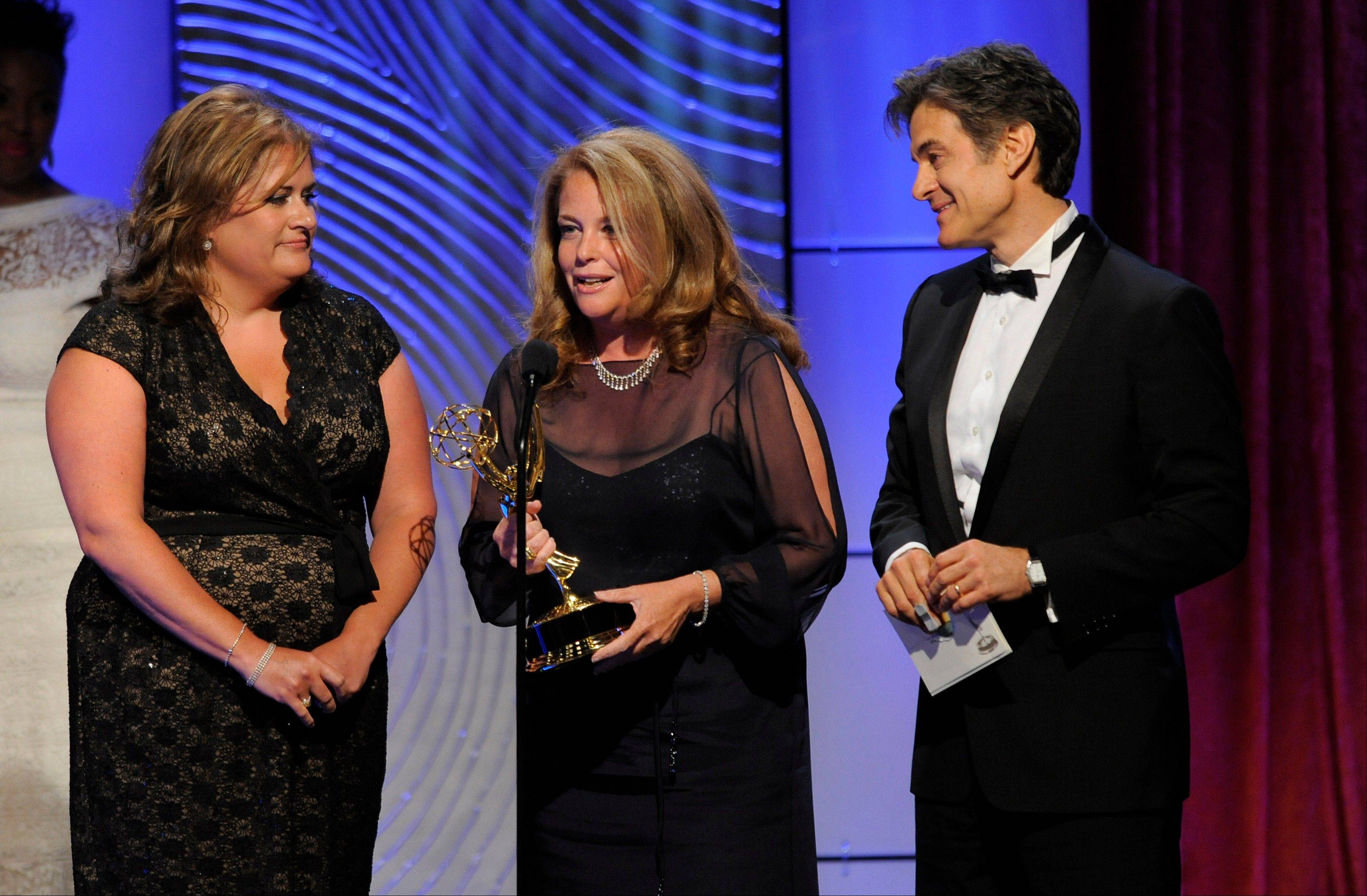 "Amy Chiaro, from left, Mindy Borman and Mehmet Oz, aka Dr. Oz, accept the award for outstanding talk show: informative for ""The Dr. Oz Show"" at the 40th Annual Daytime Emmy Awards on Sunday, June 16, 2013, in Beverly Hills, Calif."