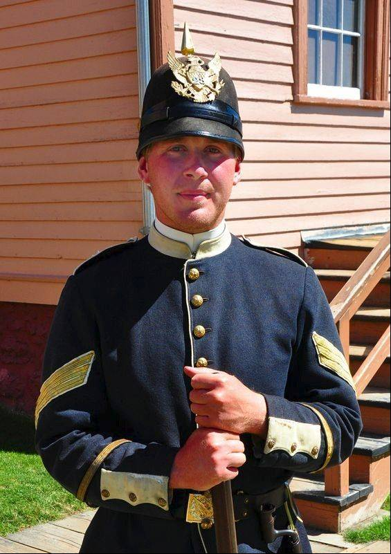 Employees posing as Fort Mackinac soldiers wear the Prussian-inspired costumes of the 19th century.