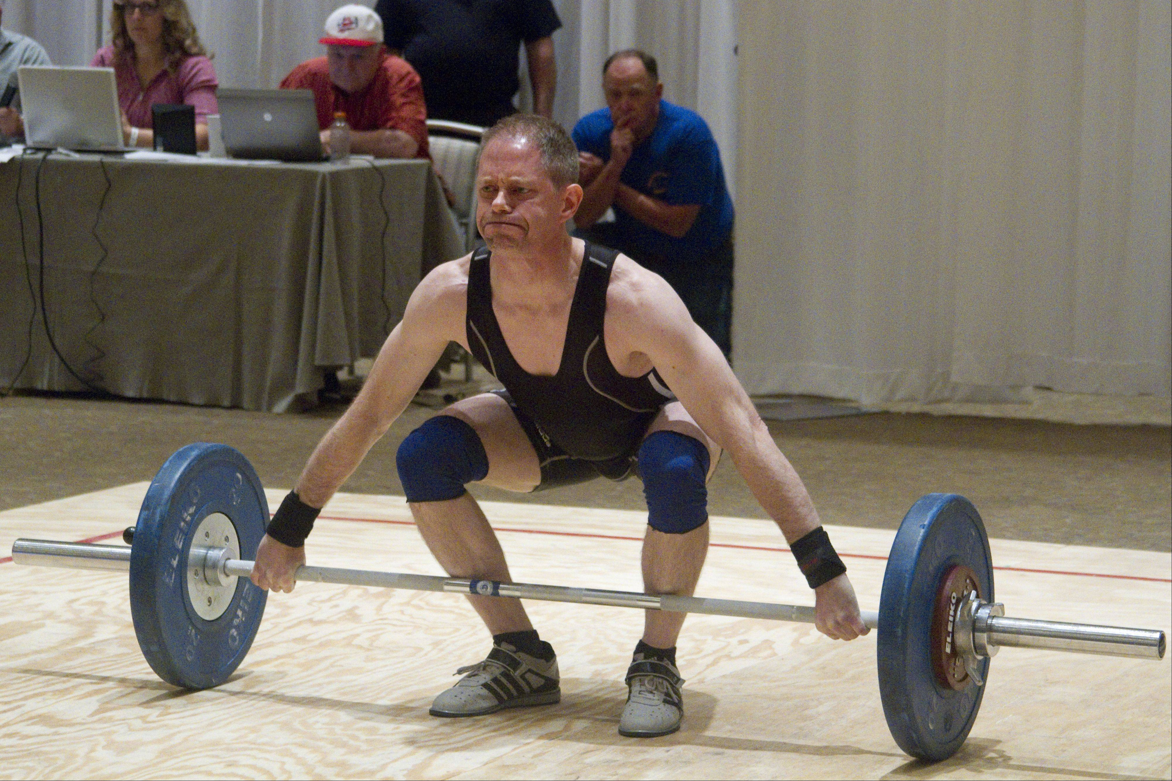 Mark Hummel, a weightlifter representing the United States, attempts to lift 70 kilograms at the 2013 Pan American Masters Weightlifting Championships Sunday in Itasca.