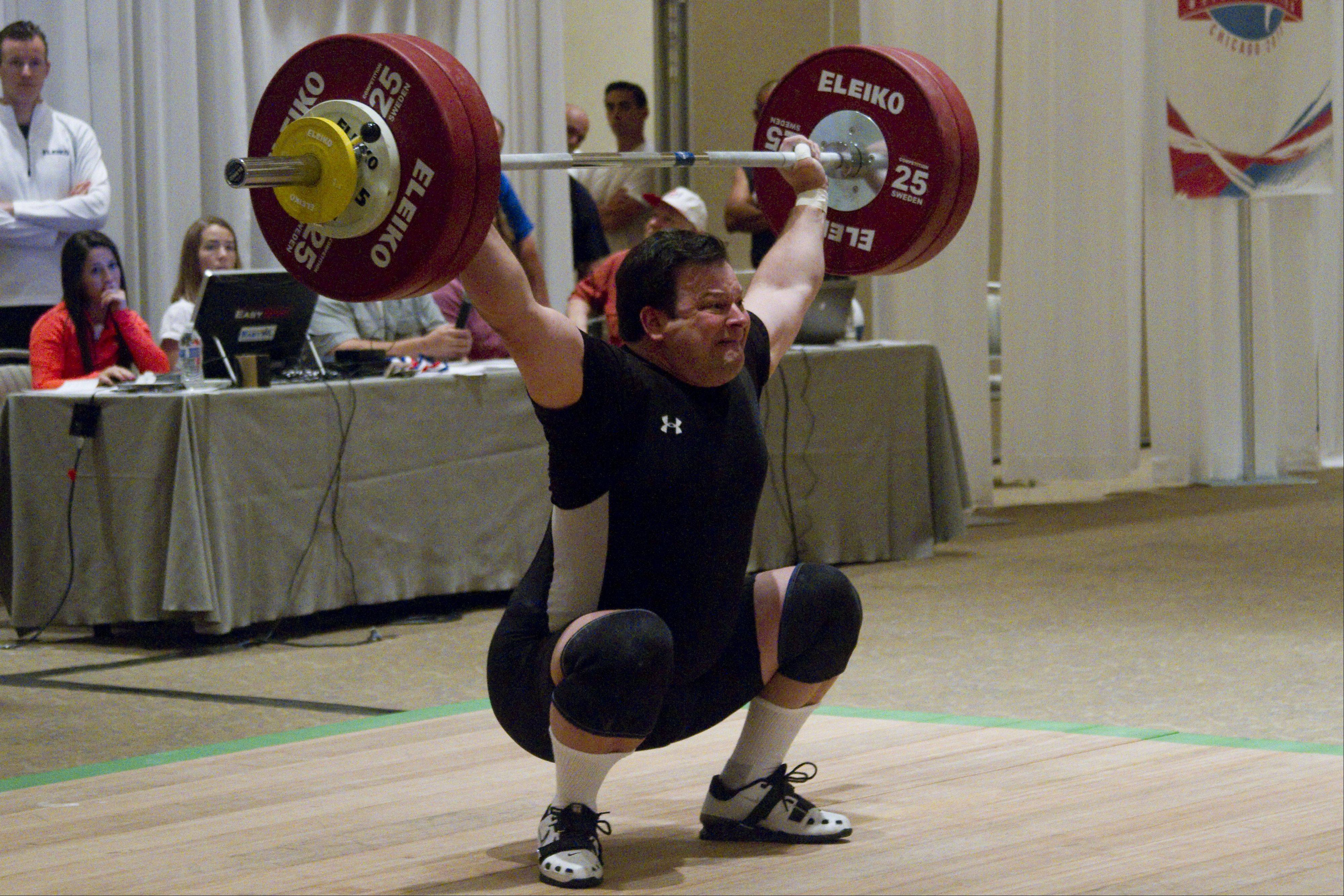 Rick Bucinell, a weightlifter representing the United States, attempts to lift 130 kilograms at the 2013 Pan American Masters Weightlifting Championships Sunday in Itasca.