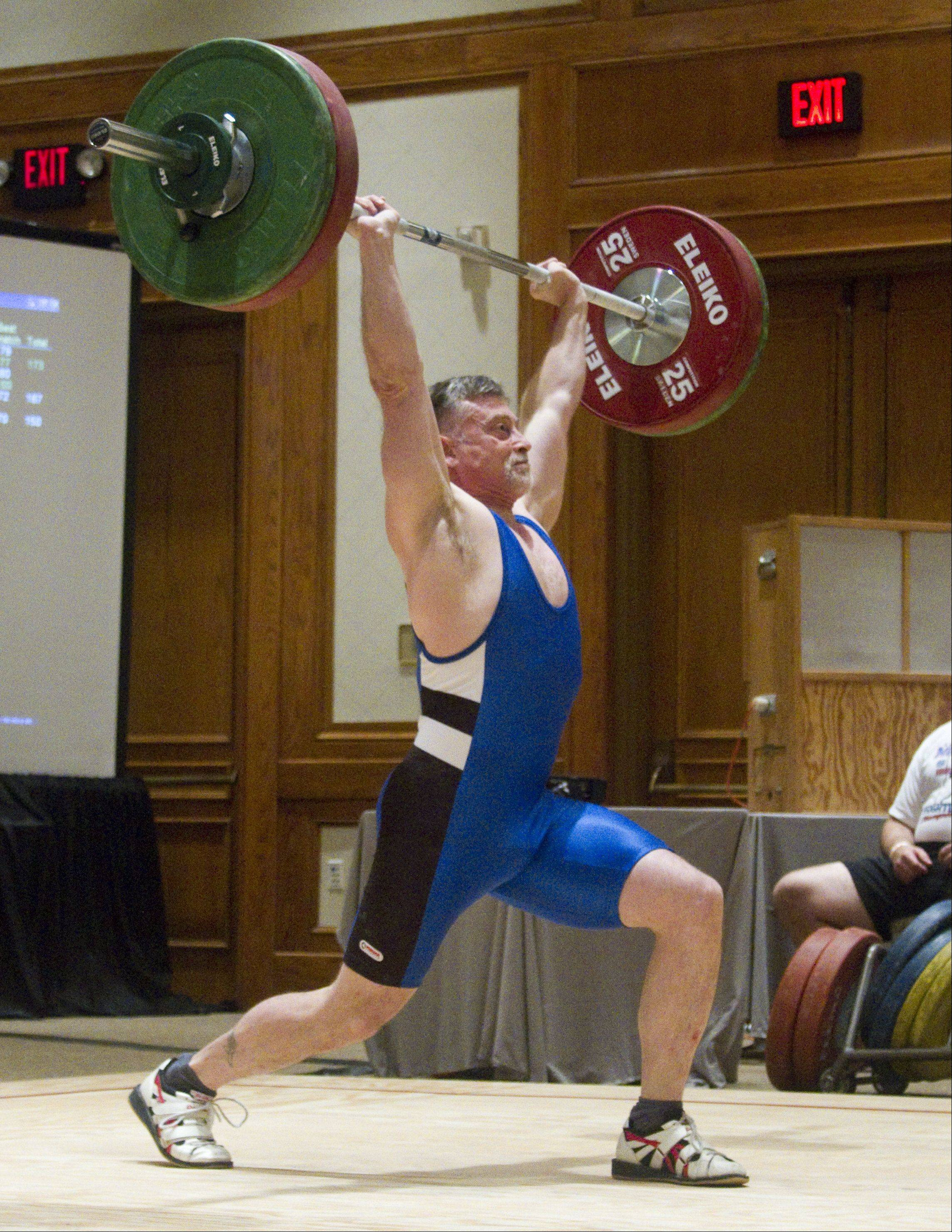 Richard Condon, a weightlifter representing the United States, attempts to lift 87 kilograms at the 2013 Pan American Masters Weightlifting Championships Sunday in Itasca.