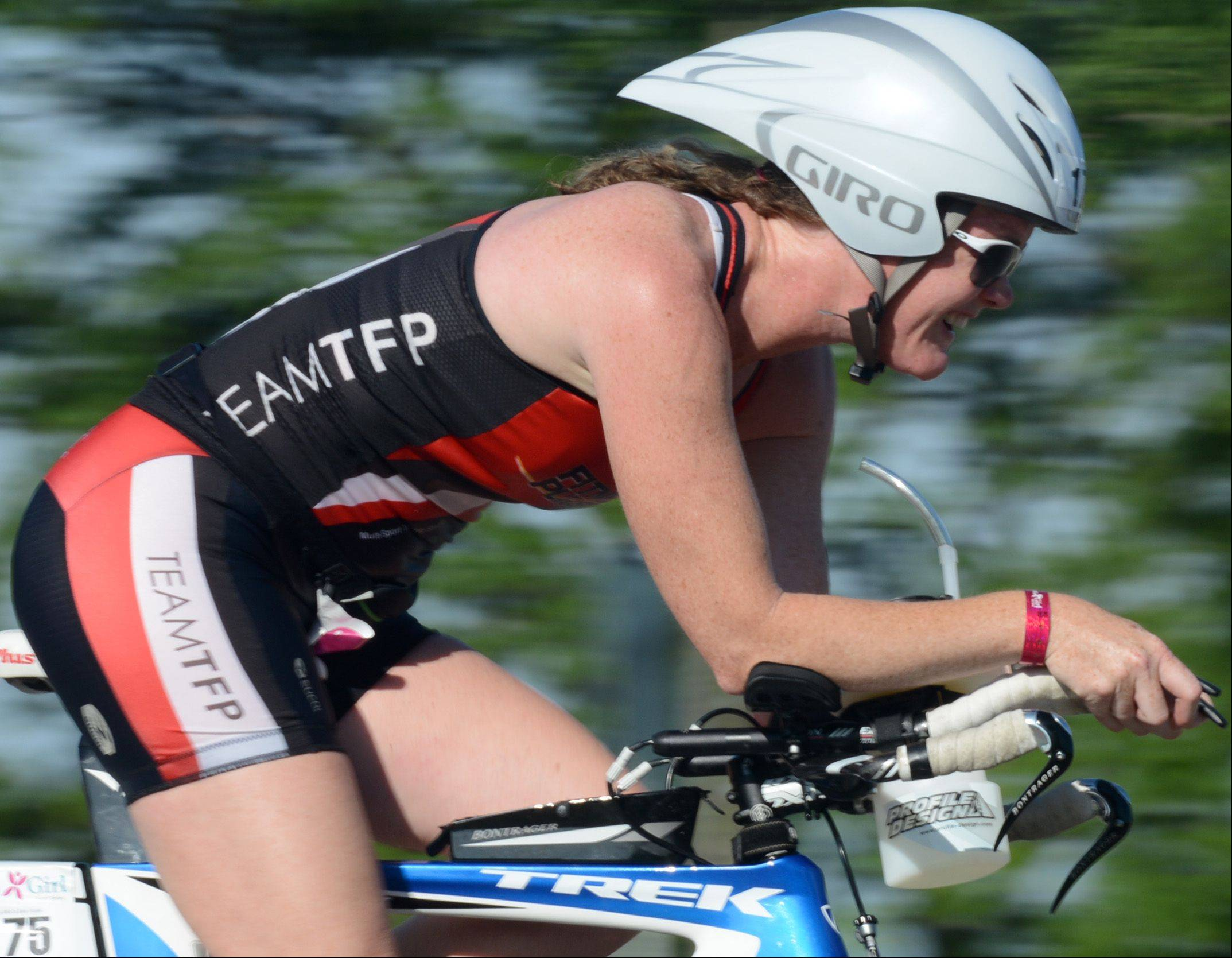 Andrea Collins, of Mundelein, competes in the Athleta Iron Girl Triathlon in Lake Zurich Sunday.