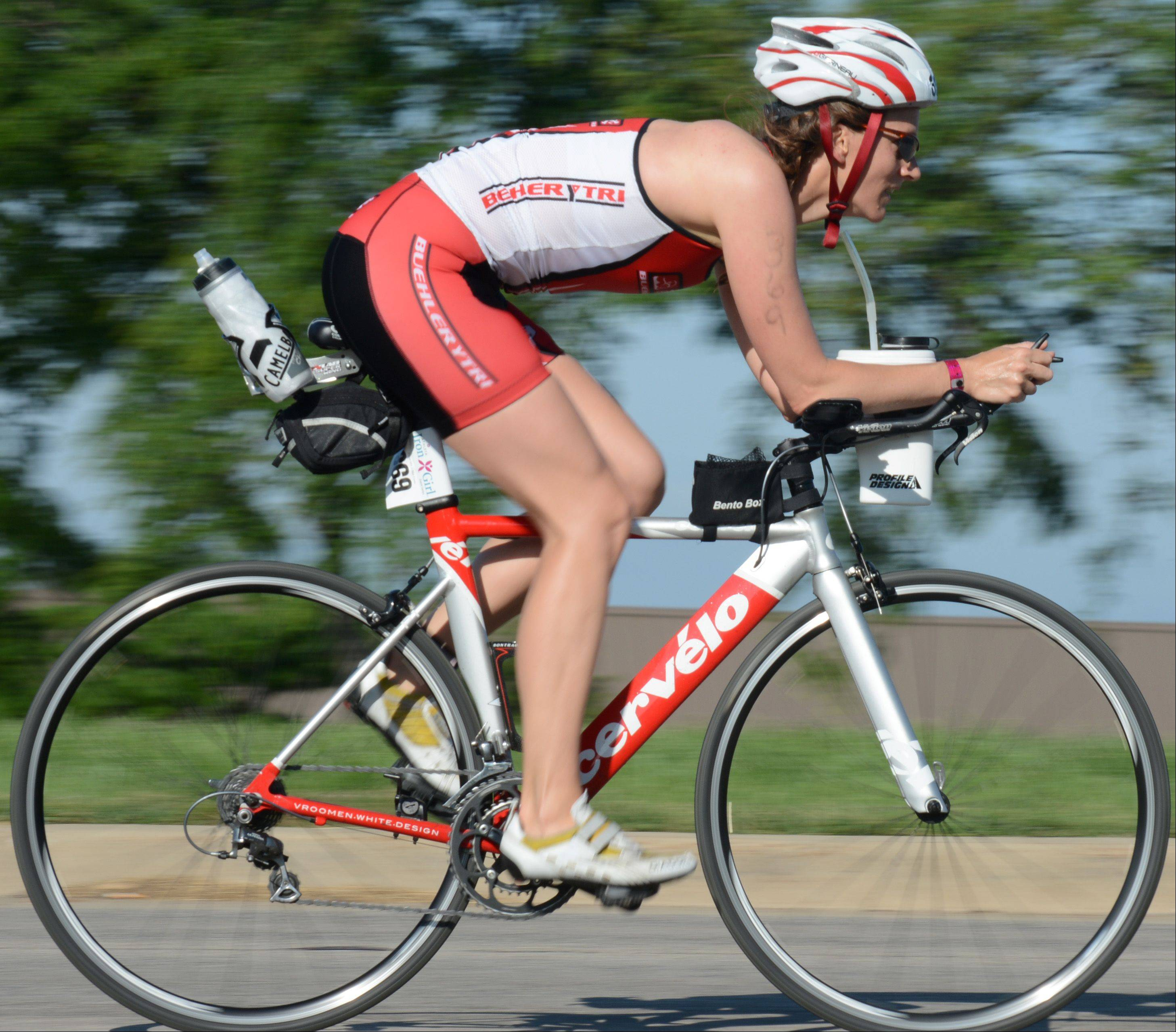 Marsha McCreary, of Barrington, bikes during the Athleta Iron Girl Triathlon in Lake Zurich Sunday.