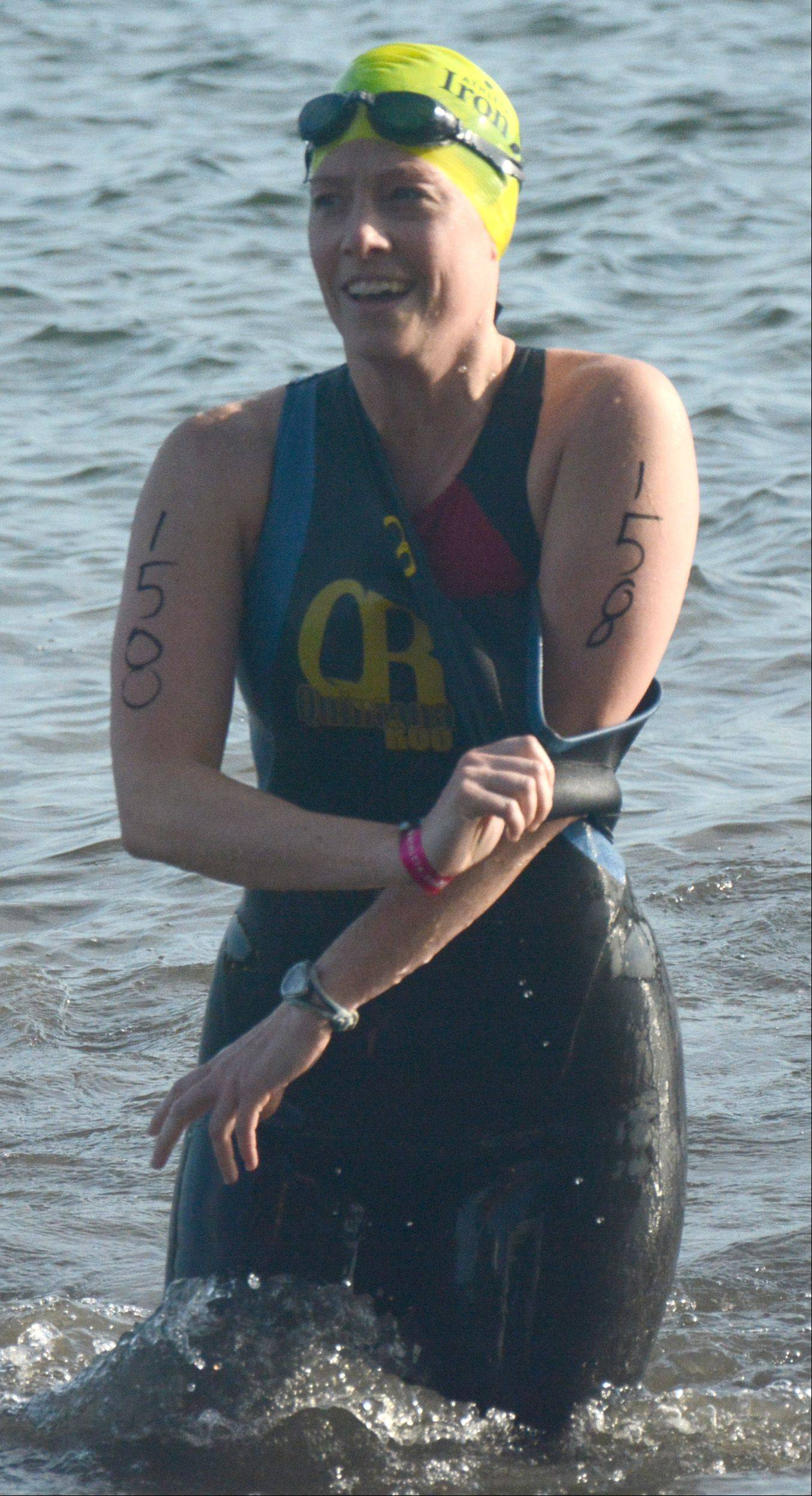Bethany Richards, of Chicago, steps out of the water and prepares for the biking portion of the Athleta Iron Girl Triathlon in Lake Zurich Sunday.
