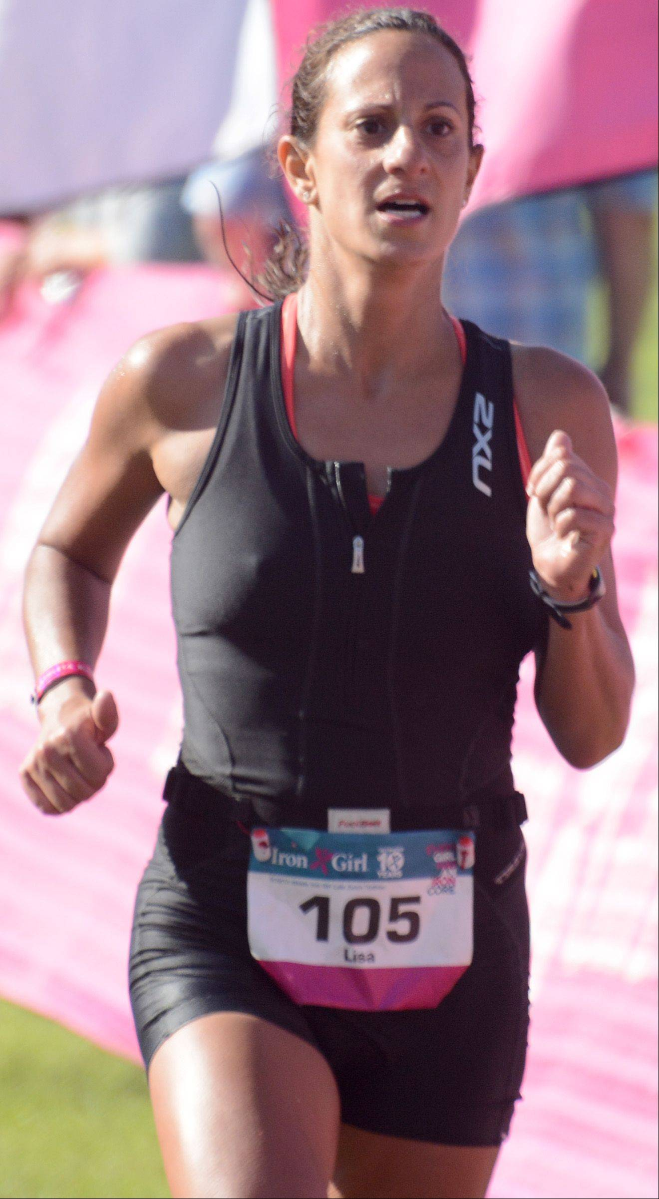 Lisa Bishop, of Carol Stream, competes in the Athleta Iron Girl Triathlon in Lake Zurich Sunday.
