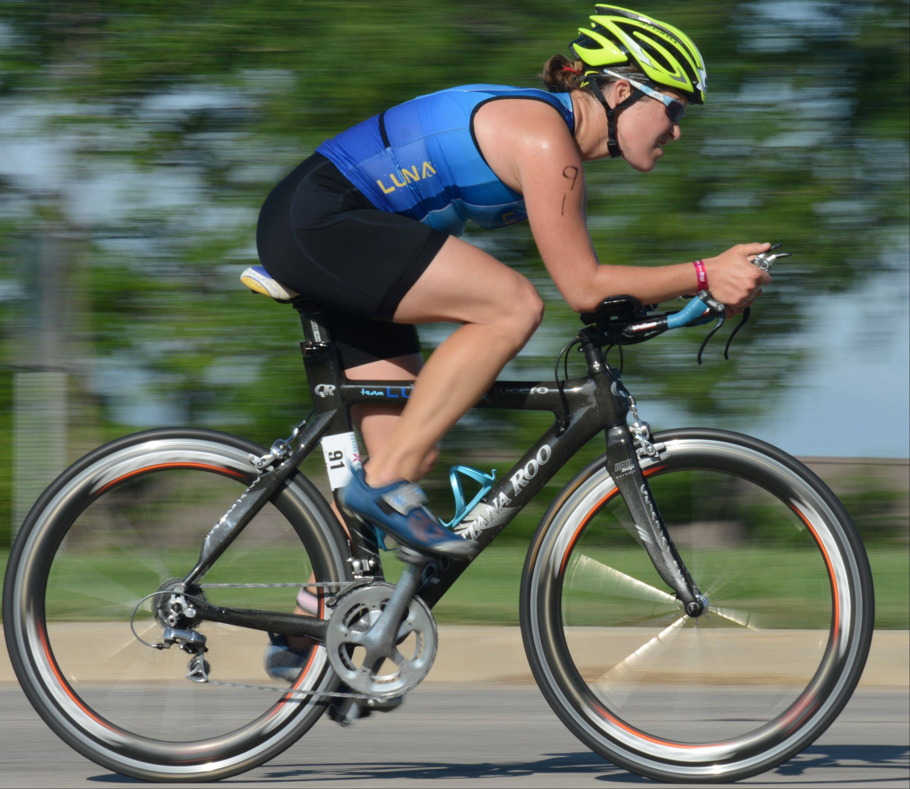 Stephanie Skladzien, of Kildeer, bikes during the Athleta Iron Girl Triathlon in Lake Zurich Sunday.
