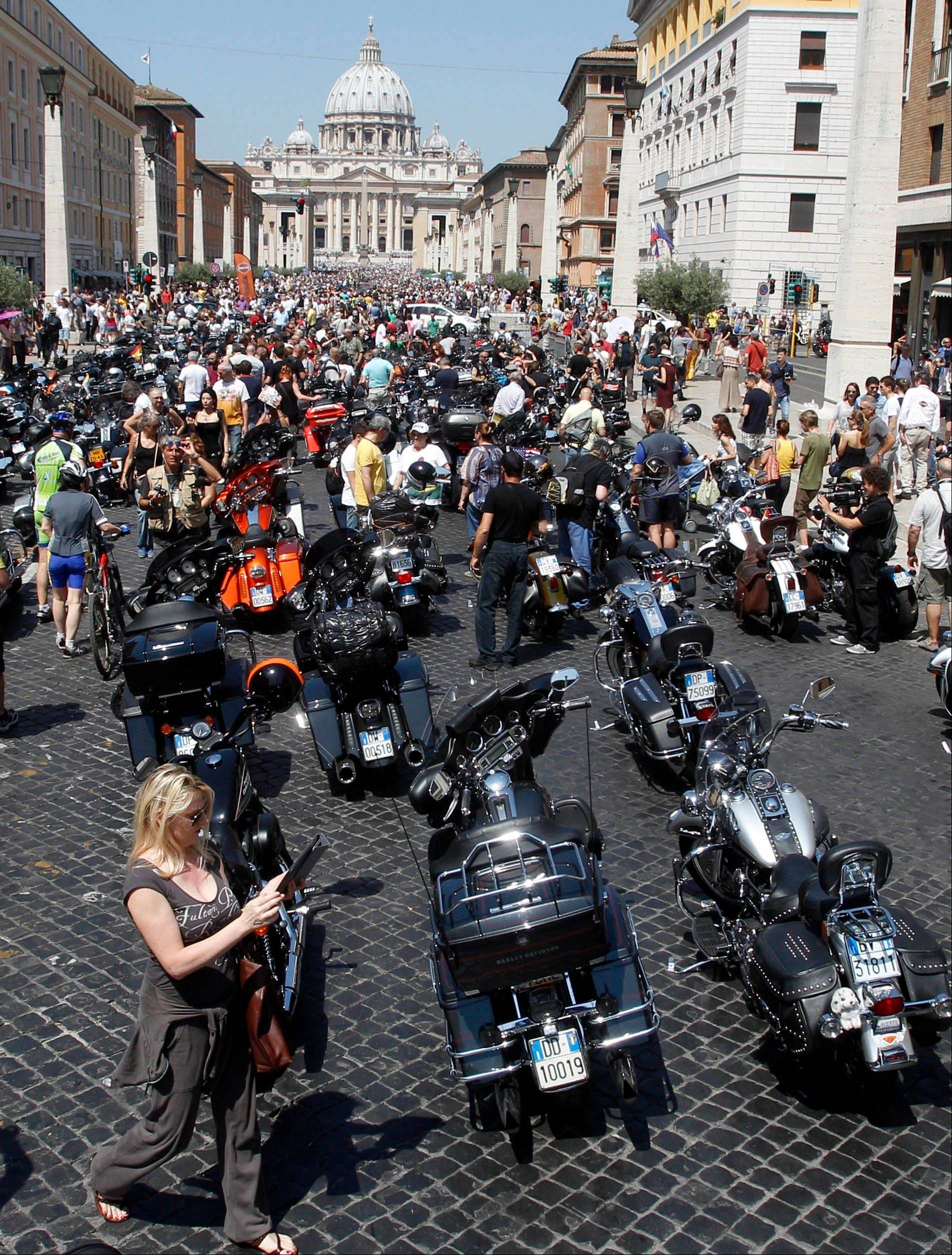 Harley-Davidson motorcycles are parked in Via della Conciliazione leading to St. Peter's Square during a Mass celebrated by Pope Francis, at the Vatican Sunday.