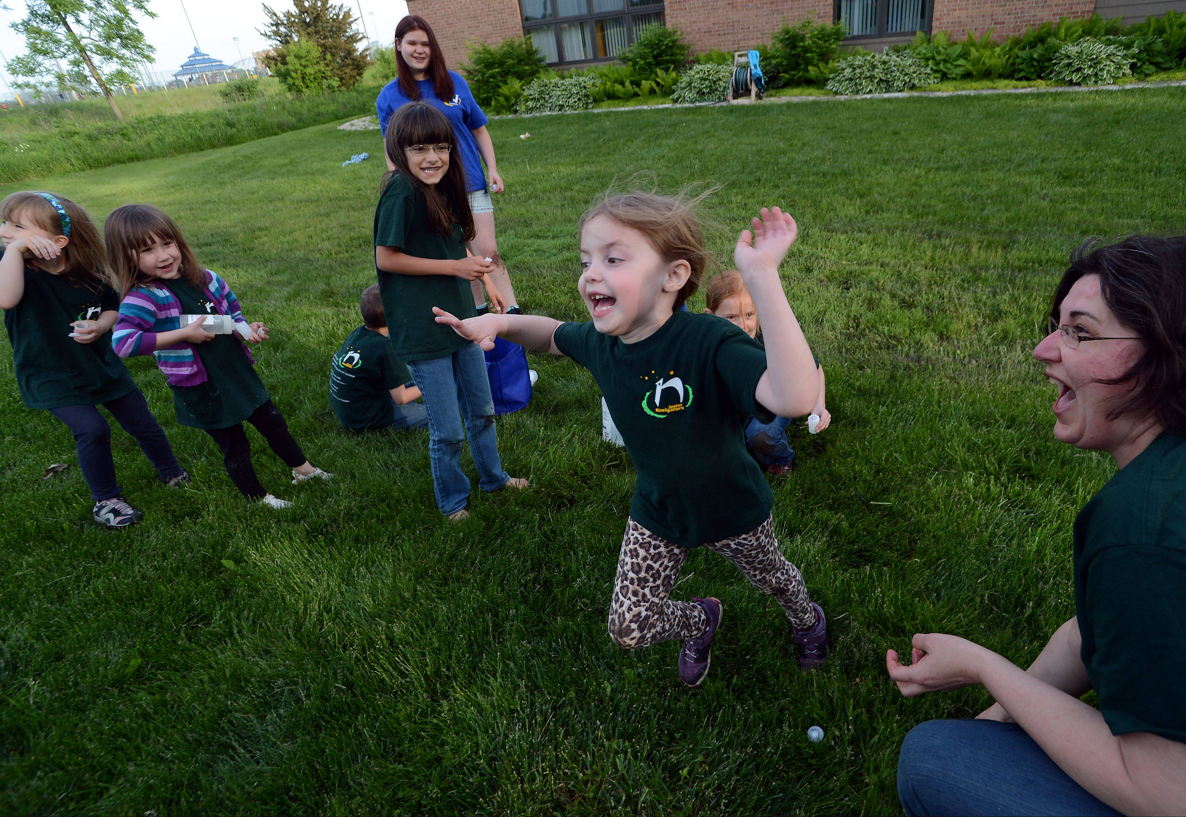 "Elizabeth Vesto of Kildeer, right, co-founder of the Palatine chapter of Navigators USA, an ""inclusive"" alternative to Boy Scouts, plays with a group of kids at the Countryside Church Unitarian Universalist in Palatine."