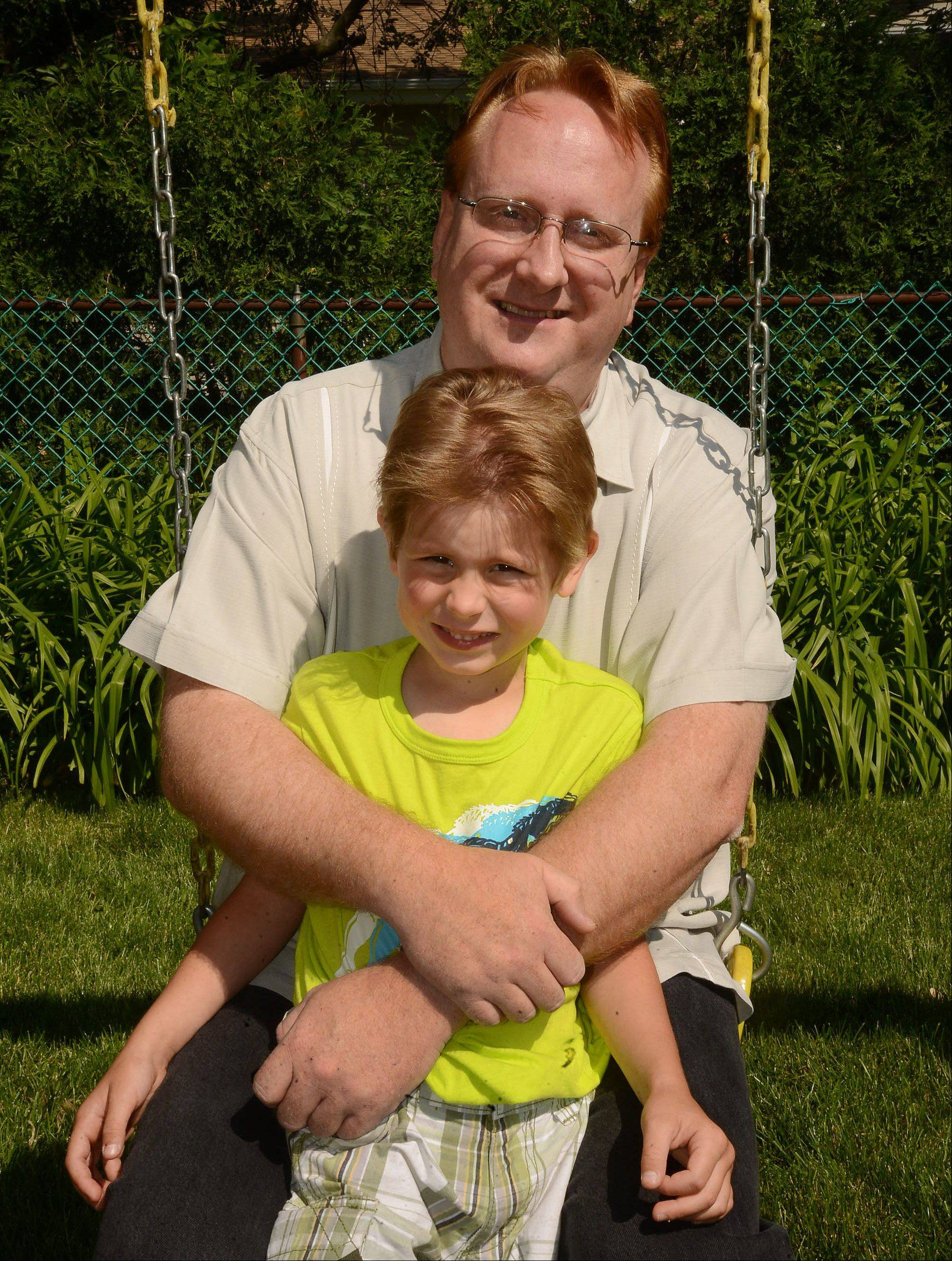 Enjoying a moment on the backyard playset with his son, Anthony, Richard Say of Schaumburg says all the hurdles that came before he and his wife, Tambra, adopted the boy from Russia give him a deep appreciation for the joys of fatherhood.