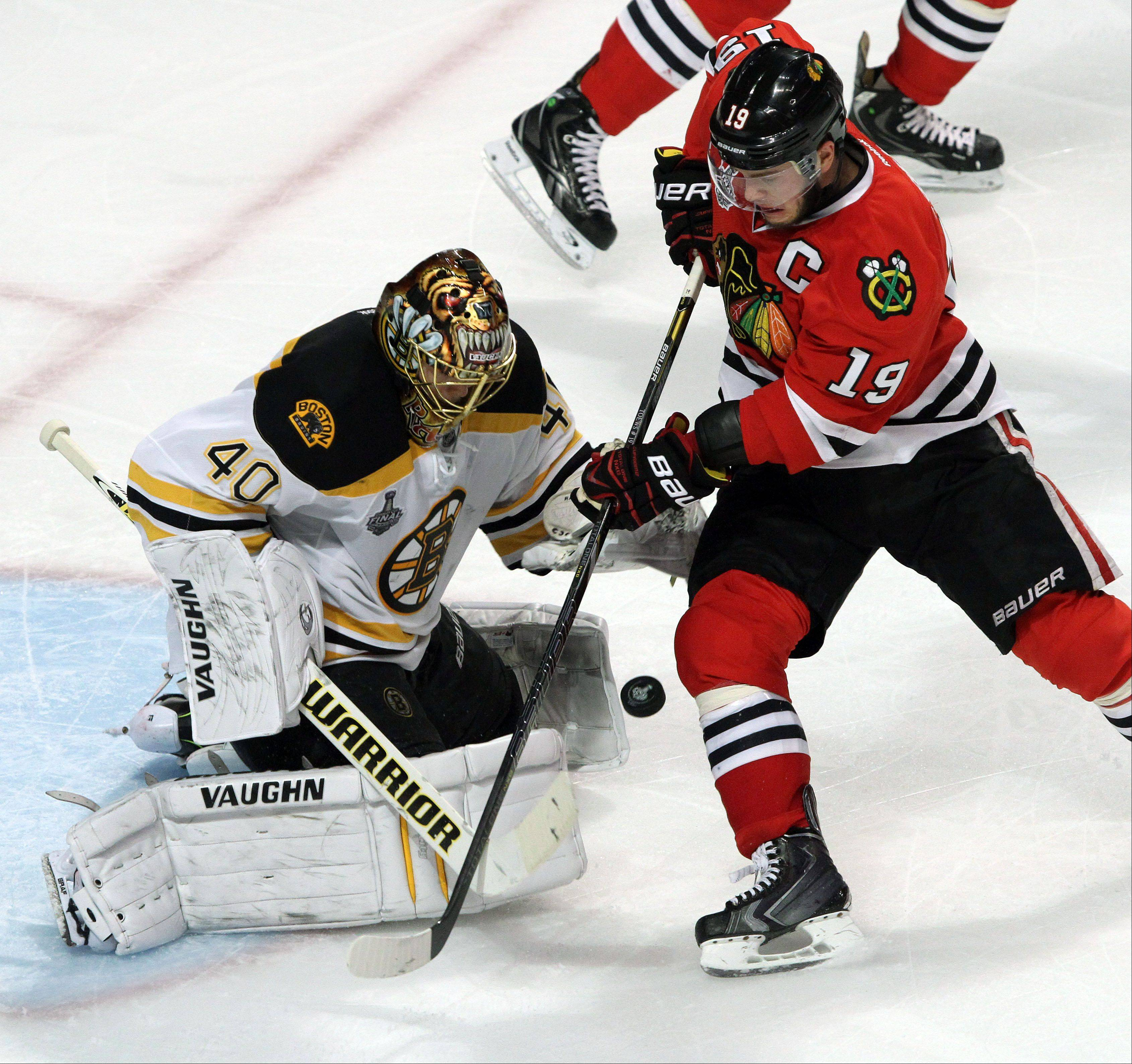 Blackhawks center Jonathan Toews shoots on Bruins goalie Tuukka Rask during Game 2 of the Stanley Cup Final at the United Center on Saturday.