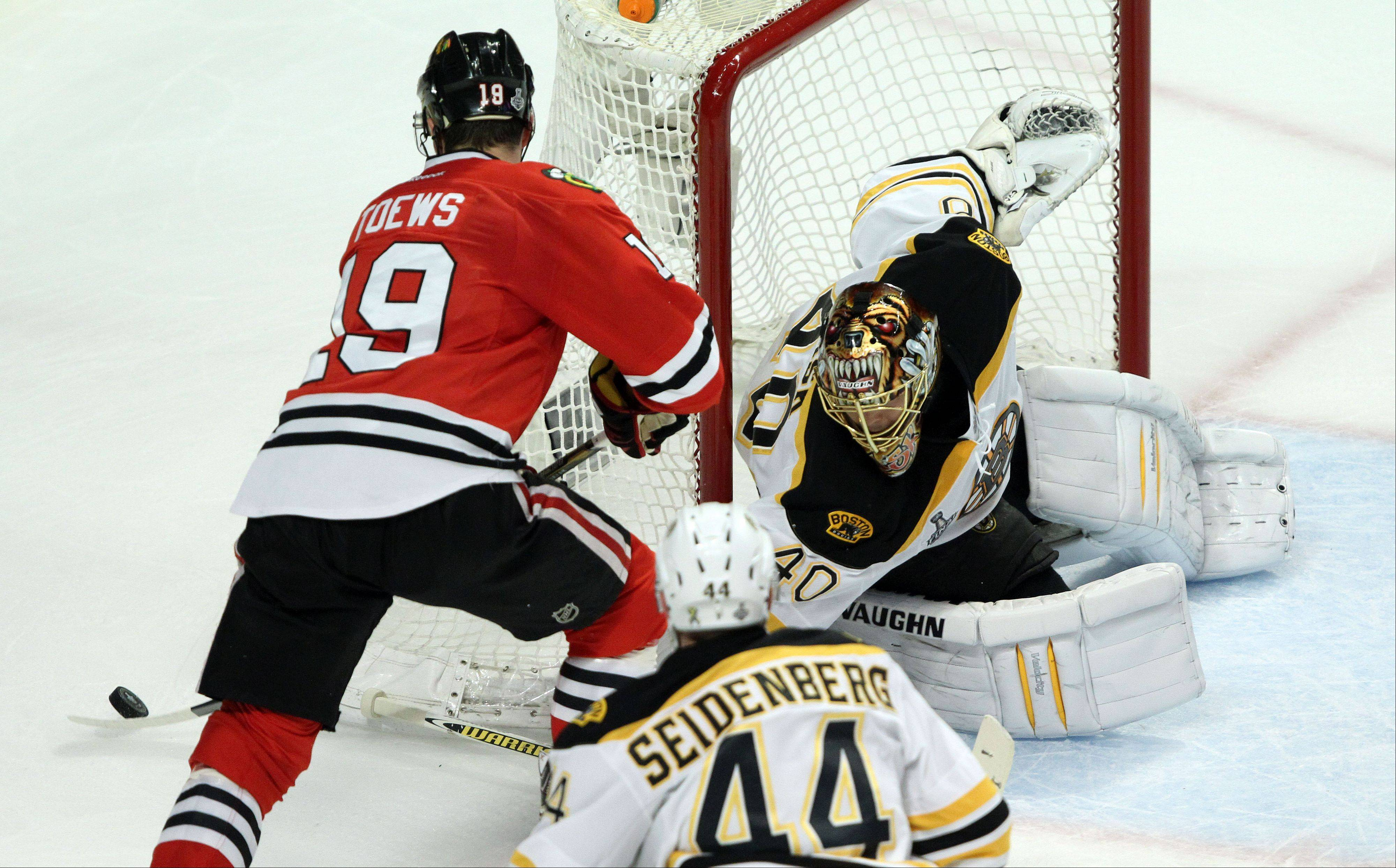 Blackhawks center Jonathan Toews tries a wrap around on Boston Bruins goalie Tuukka Rask during game 2 of the Stanley Cup Final at the United Center on Saturday.