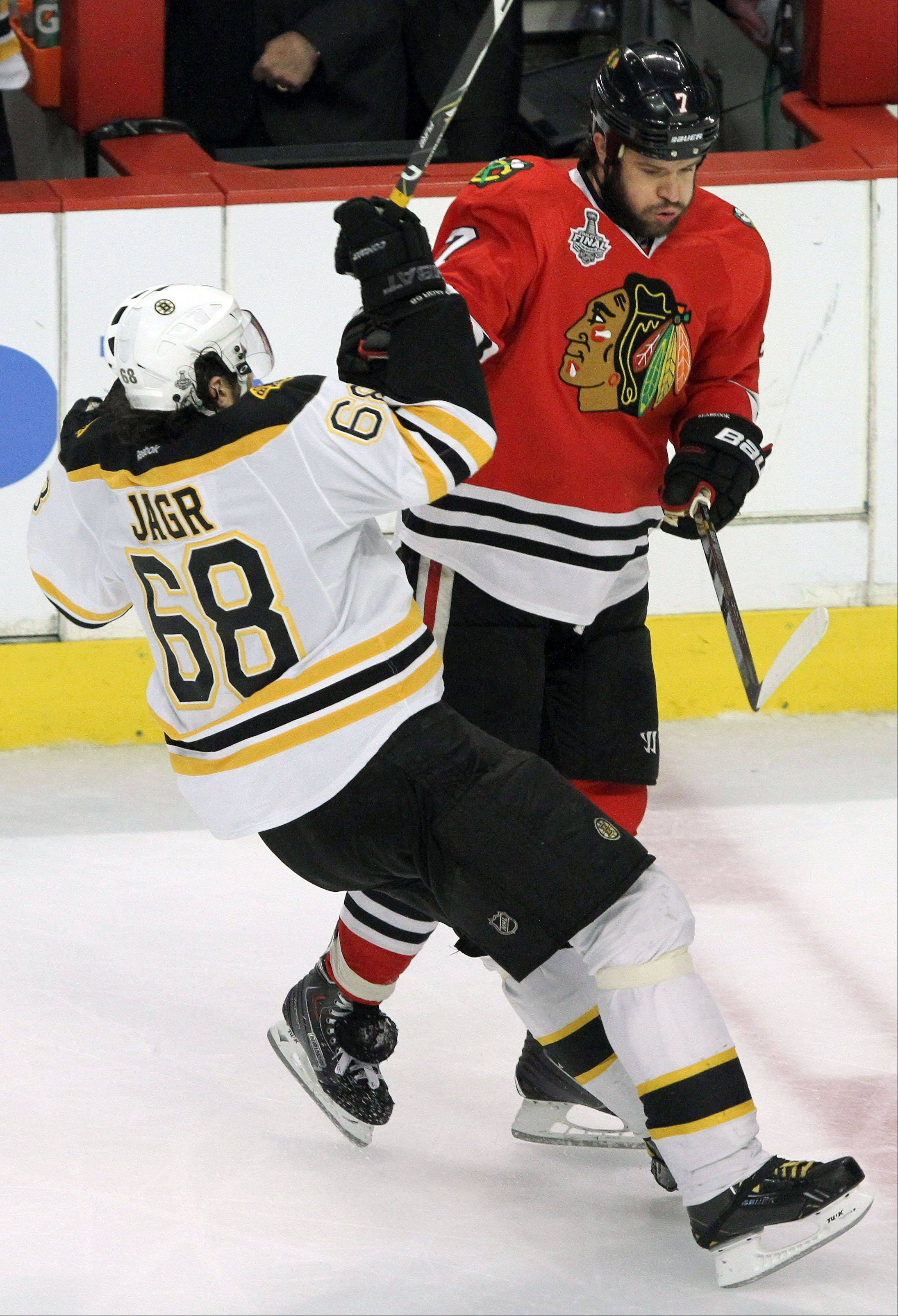 Blackhawks defenseman Brent Seabrook puts a hit on Boston Bruins right wing Jaromir Jagr during game 2 of the Stanley Cup Final against the Boston Bruins at the United Center on Saturday.