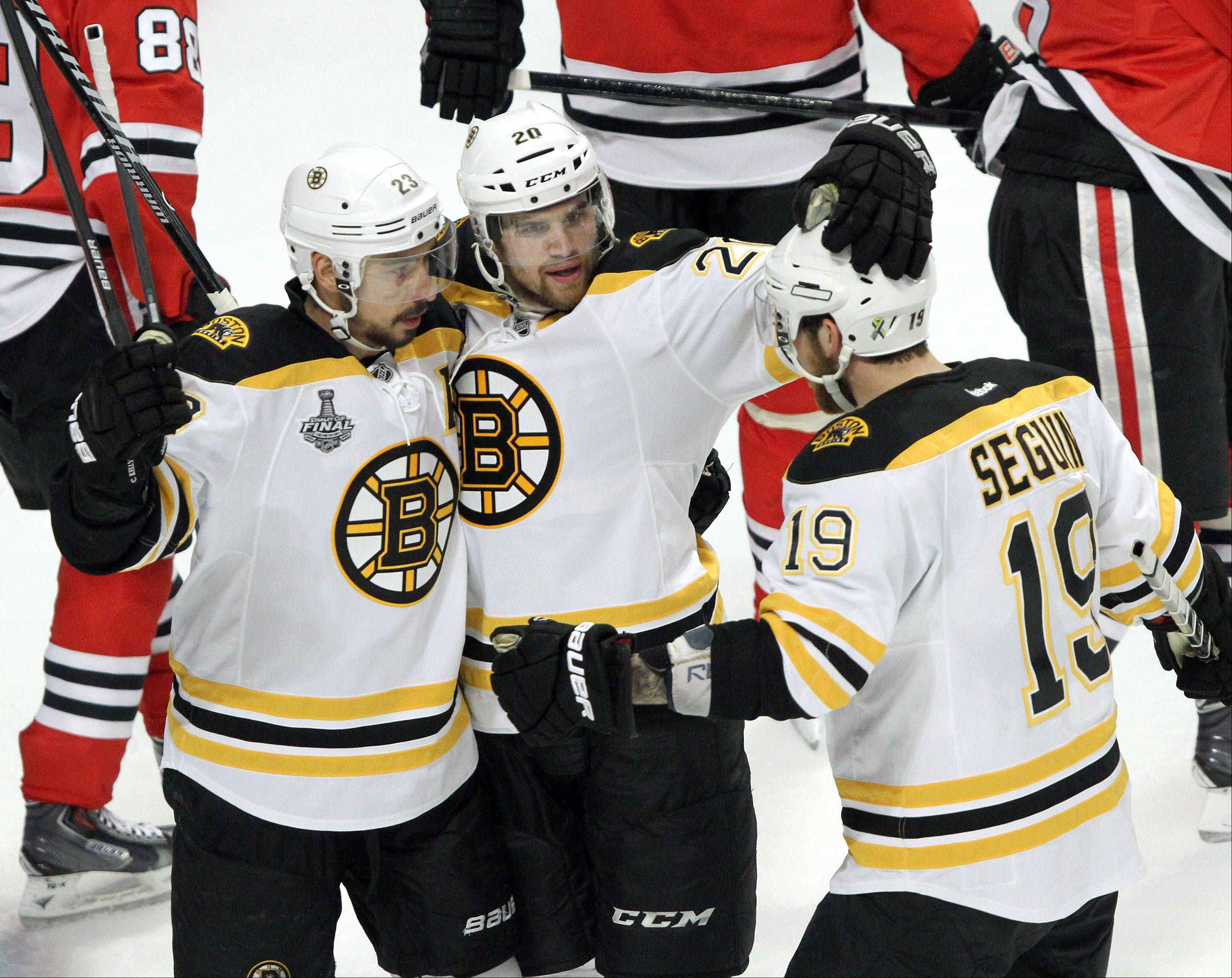 Bruins players celebrate a 2nd period goal during game 2 of the Stanley Cup Finals at the United Center in Chicago Saturday.