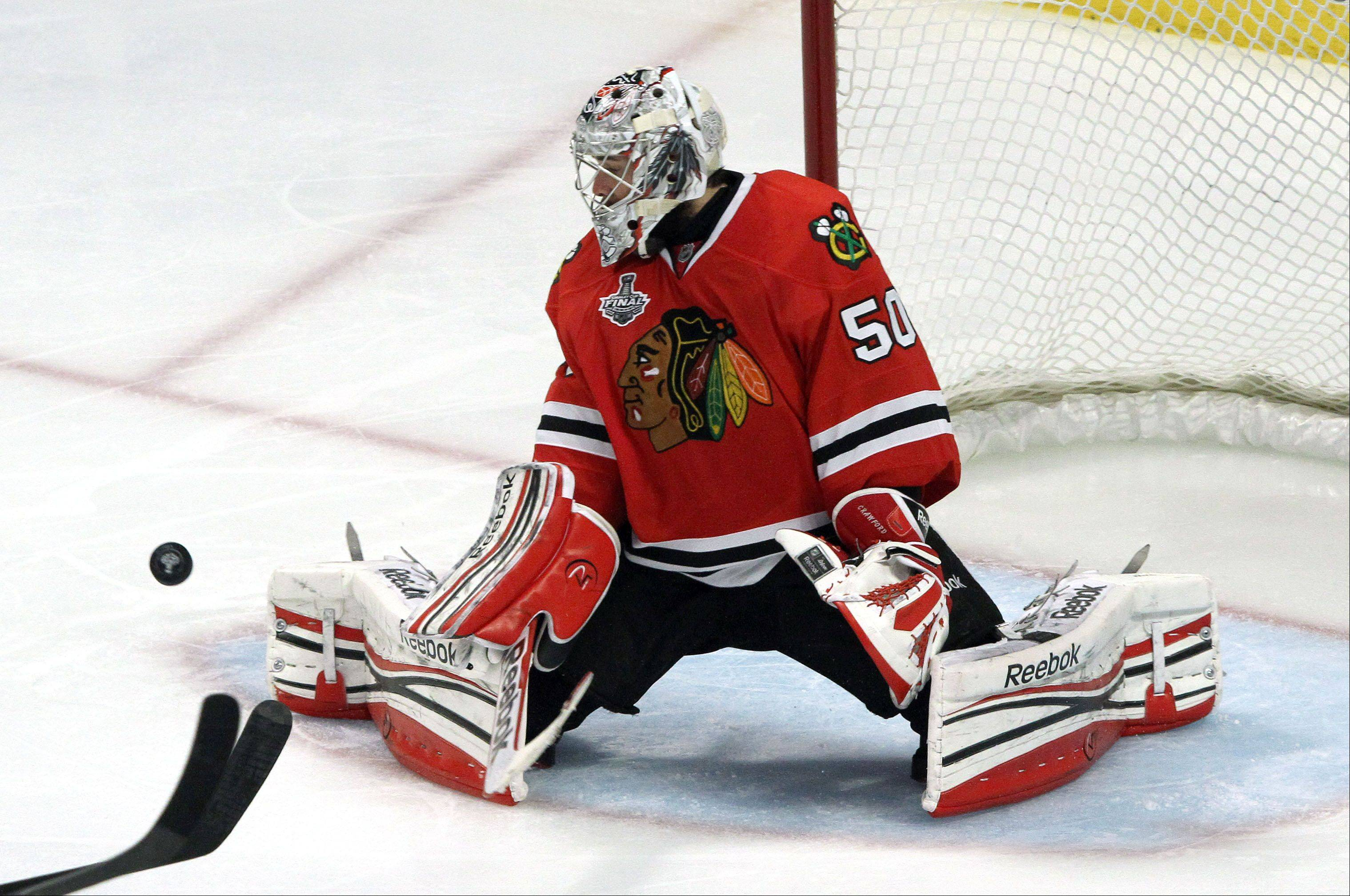 Chicago Blackhawks goalie Corey Crawford makes a save during game 2 of the Stanley Cup Finals against the Boston Bruins at the United Center in Chicago Saturday.