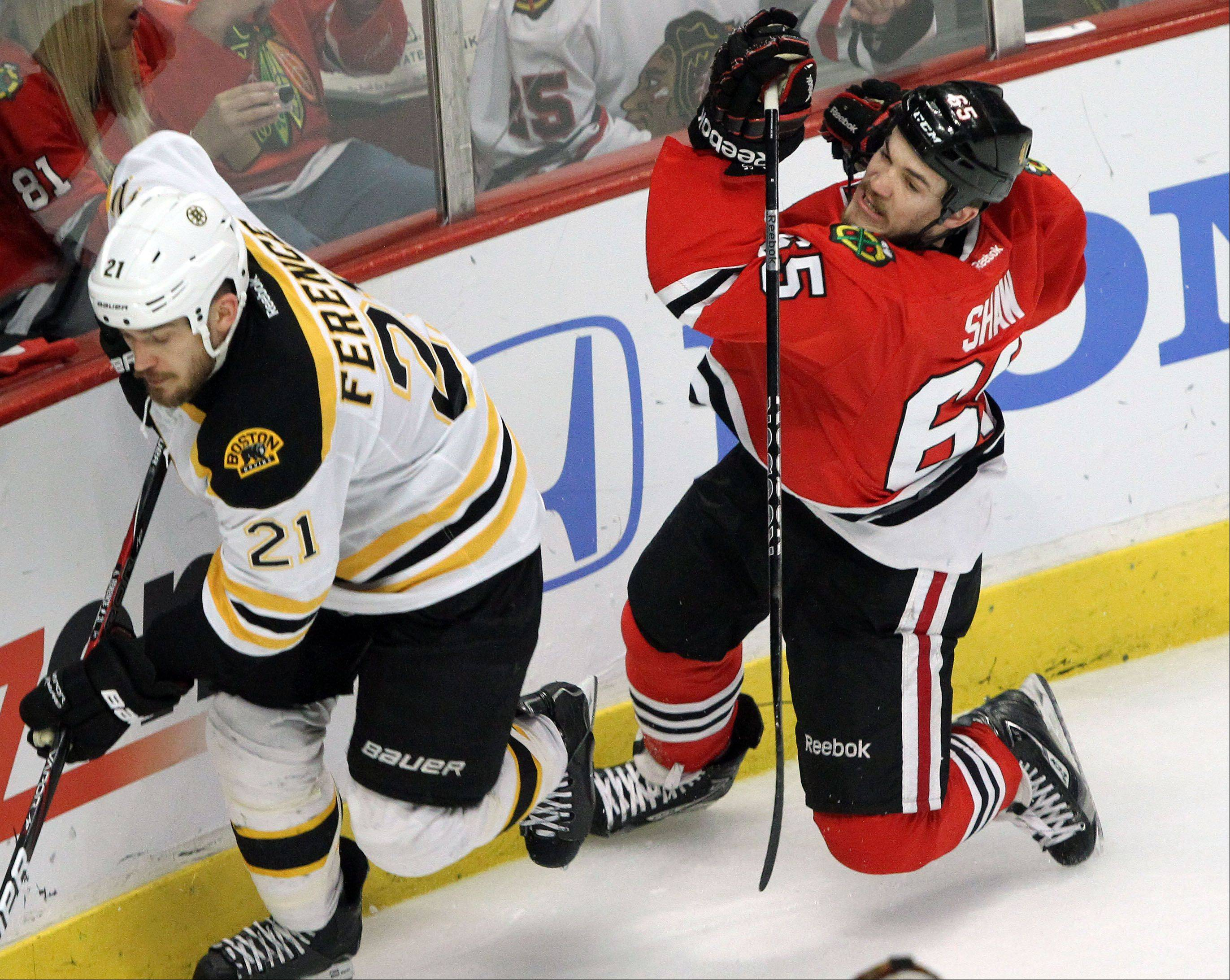 Chicago Blackhawks center Andrew Shaw collides with Boston Bruins defenseman Andrew Ference during game 2 of the Stanley Cup Finals against the Boston Bruins at the United Center in Chicago Saturday.