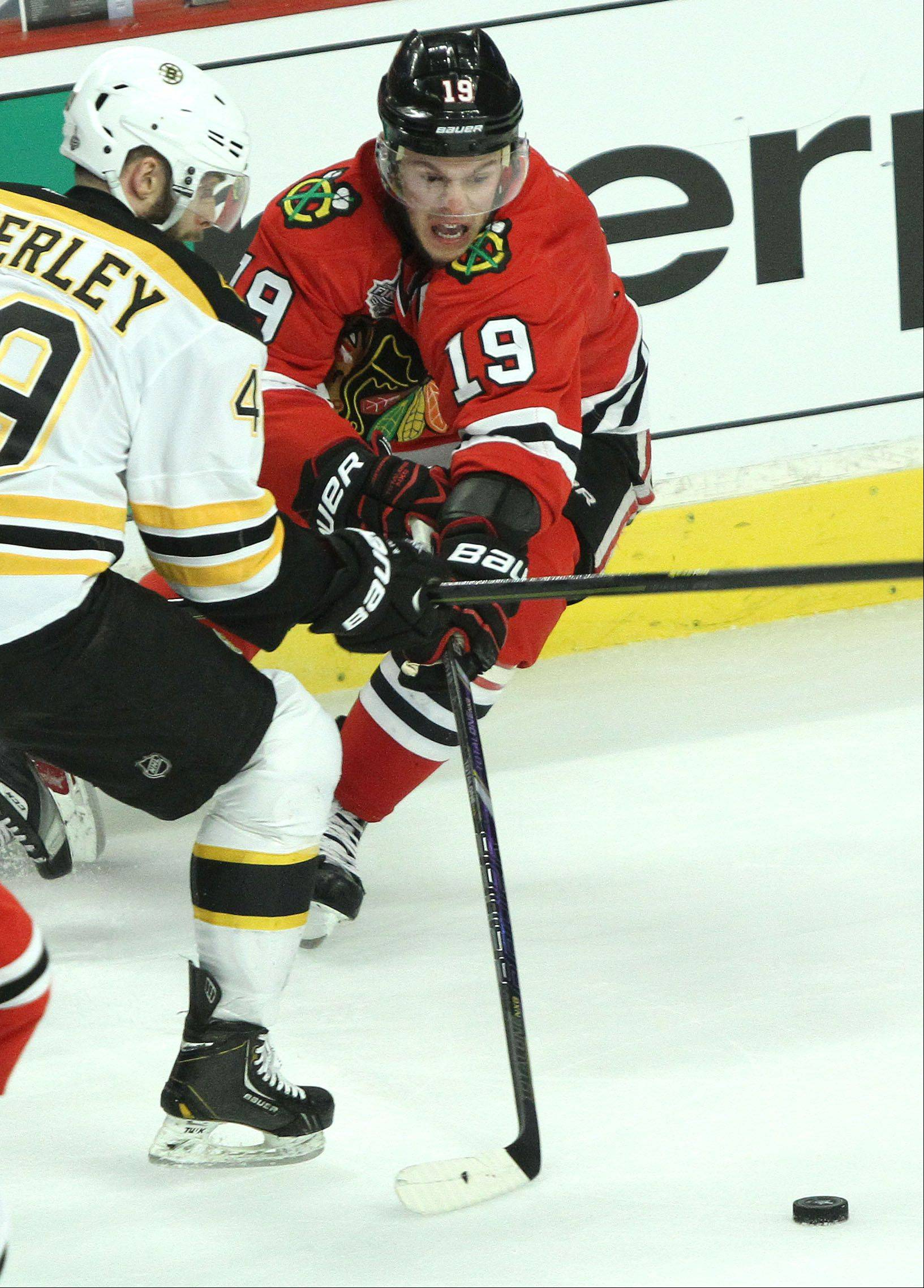 Chicago Blackhawks center Jonathan Toews battles with Boston Bruins center Rich Peverley during game 2 of the Stanley Cup Finals against the Boston Bruins at the United Center in Chicago Saturday.