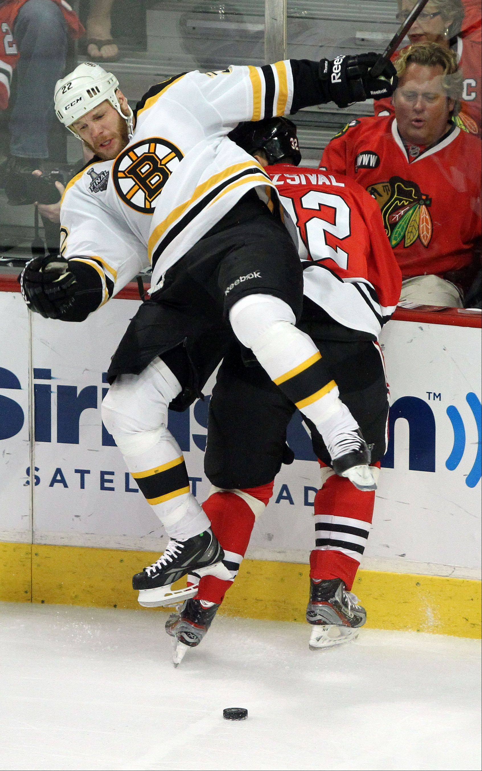 Michal Roszival gets knocked into the glass during game 2 of the Stanley Cup Finals at the United Center in Chicago Saturday.
