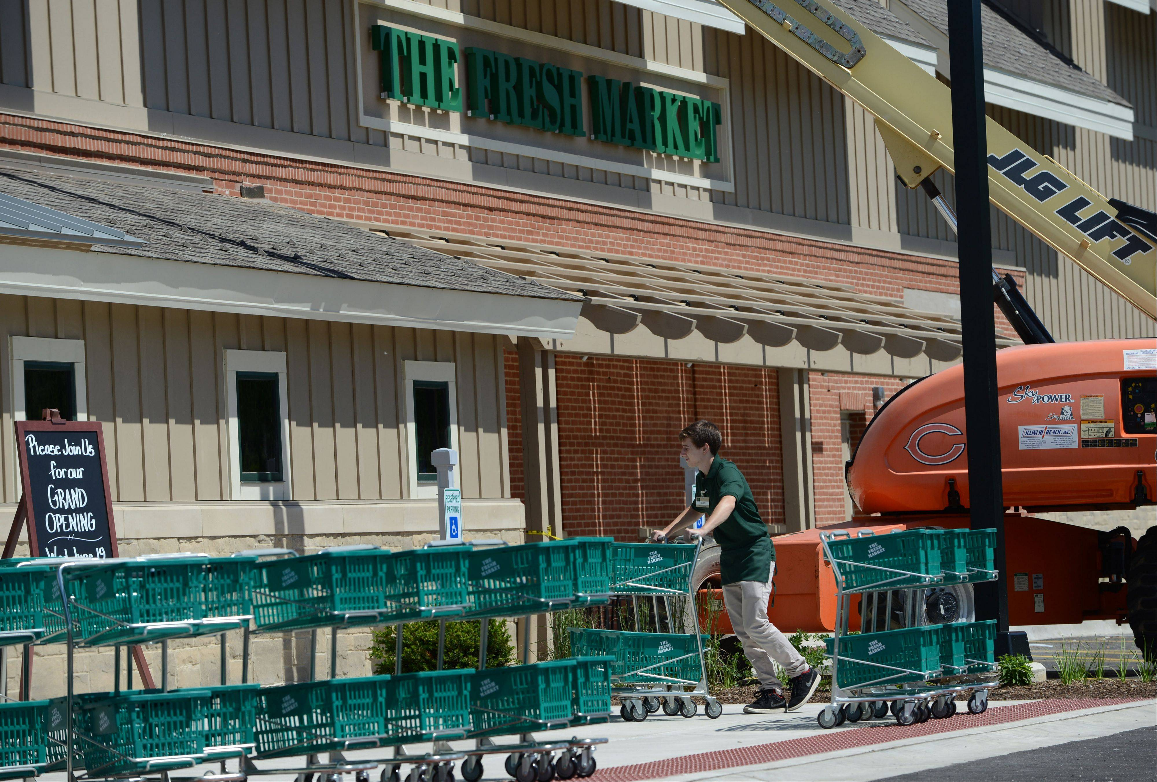 Last-minute work is under way Monday at The Fresh Market store in Lincolnshire. A grand opening is set for Wednesday.