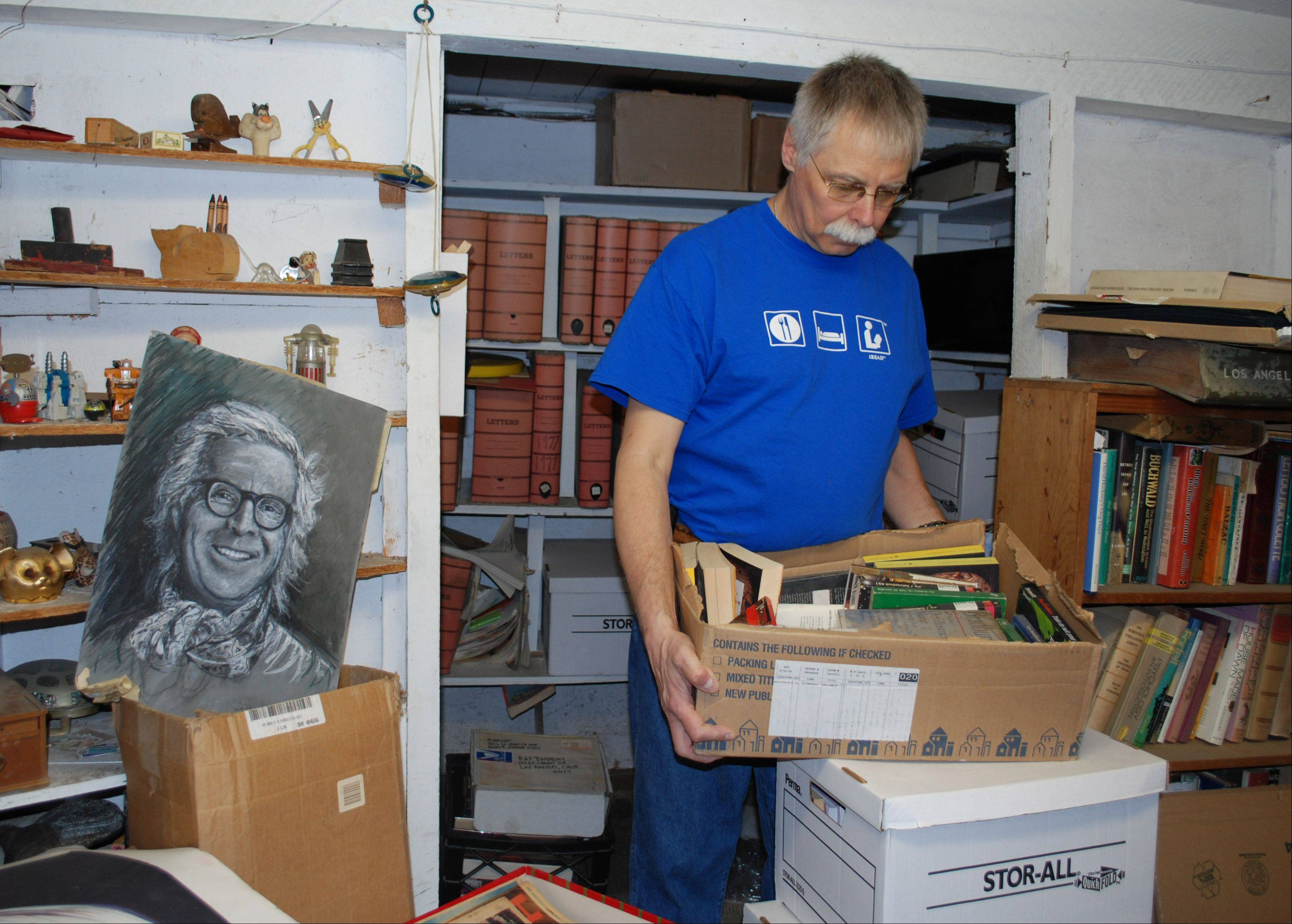 WPL Executive Director Richard Lee in Ray Bradbury�s basement looking through some of the foreign editions of his books.