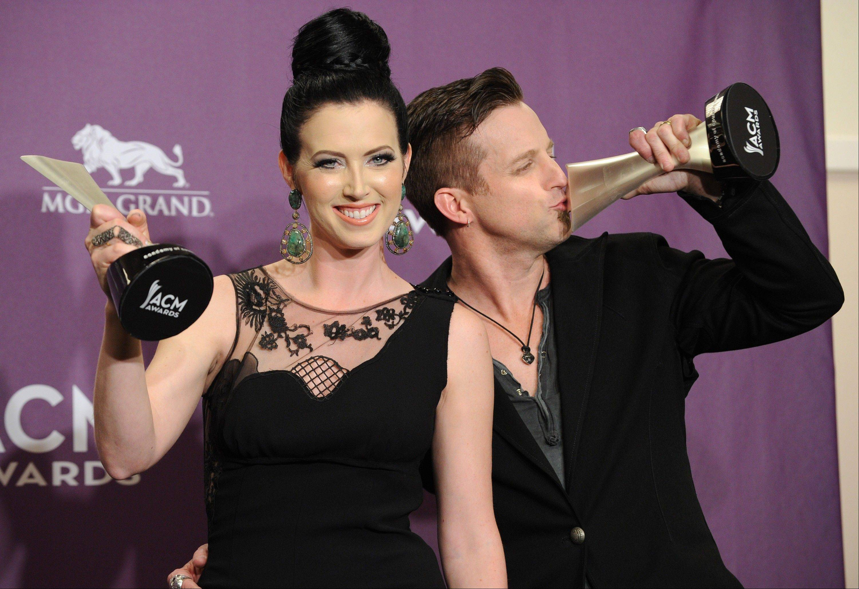 Shawna Thompson, left, and Keifer Thompson, of Thompson Square, pose backstage with the award for vocal duo of the year at the 48th Annual Academy of Country Music Awards at the MGM Grand Garden Arena in Las Vegas on April 7, 2013.
