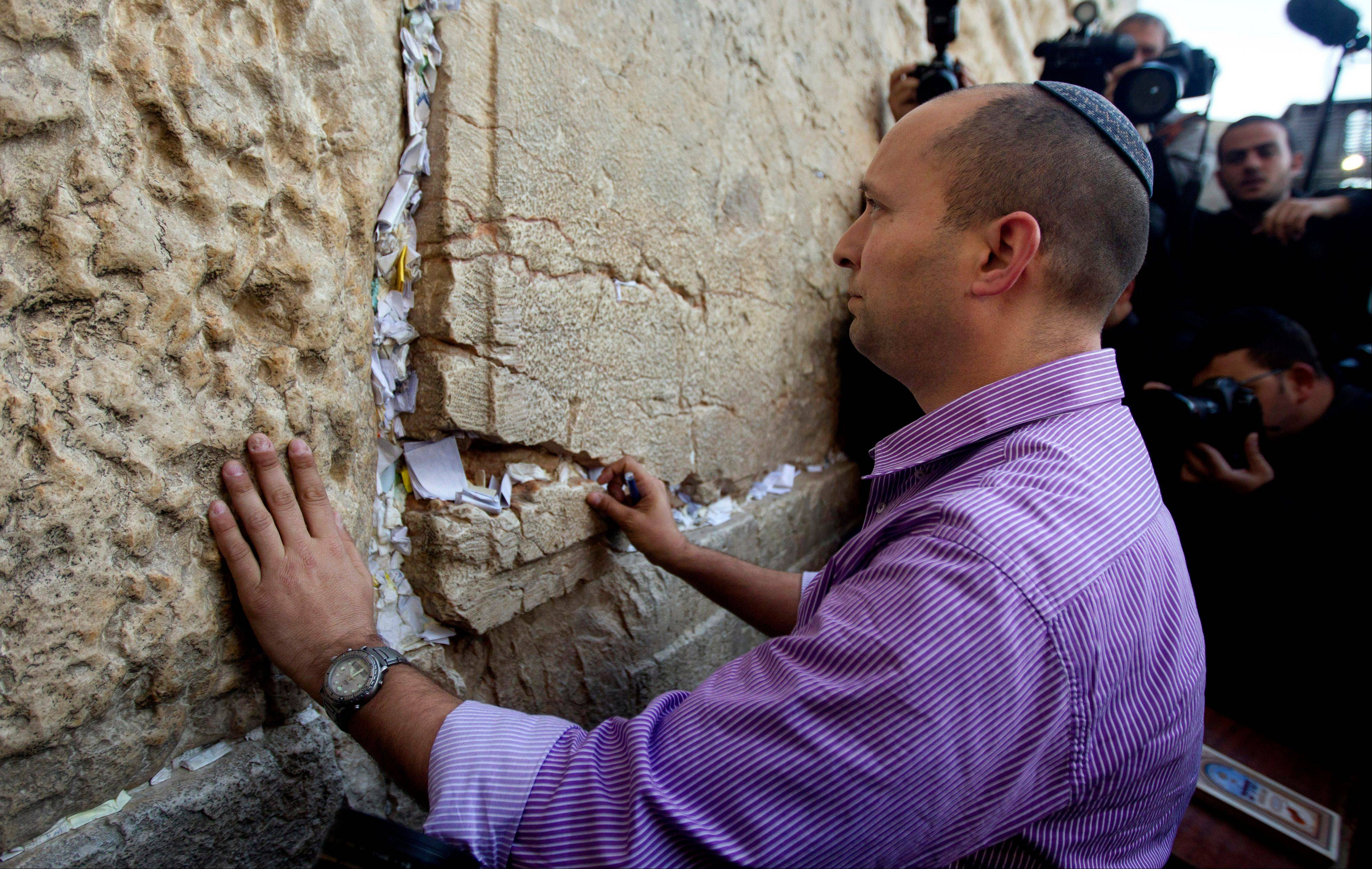 Naftali Bennett, head of the Jewish Home party, touches the stones of the Western Wall, the holiest site where Jews can pray, in Jerusalem�s Old City. The idea of Palestinians establishing a state in the territory they seek has �reached a dead end,� economics minister Naftali Bennett said Monday in the latest remarks by hard-liners that appear to contradict the country�s official support for a �two-state solution� to its conflict with the Palestinians.