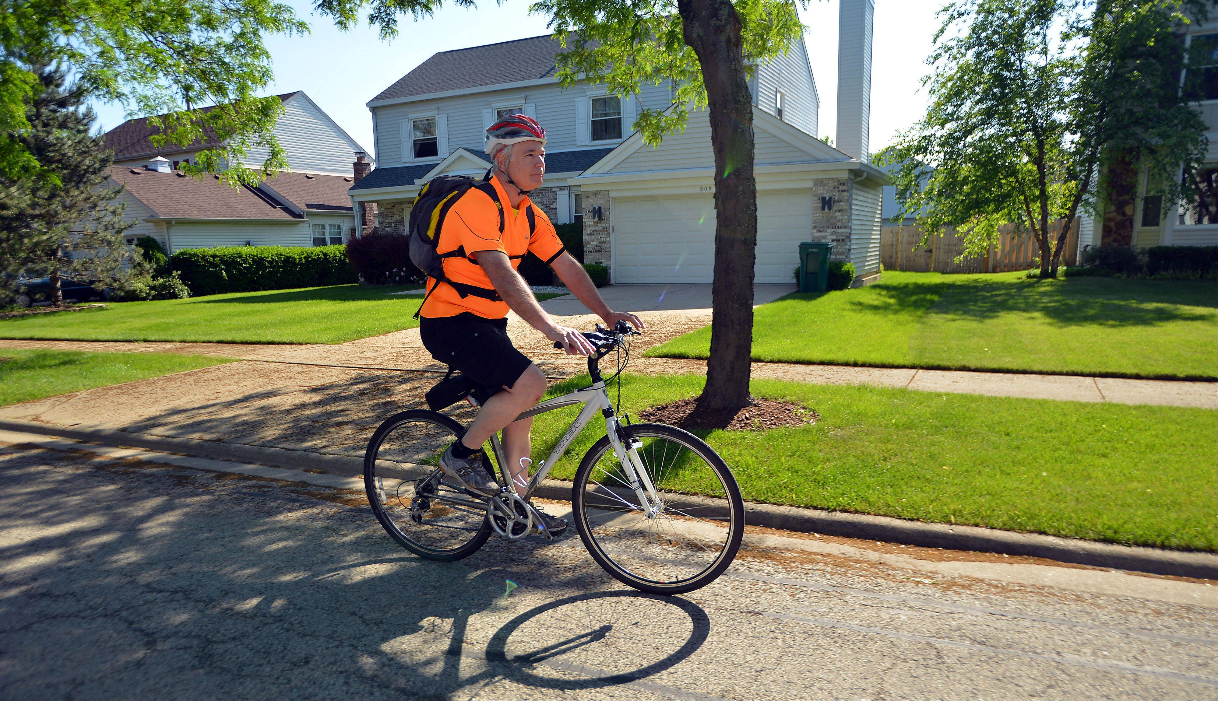 Buffalo Grove Village Planner Bob Pfeil starts out on his 50-minute ride home to Libertyville from village hall as part of the Bike Commuter Challenge last week.