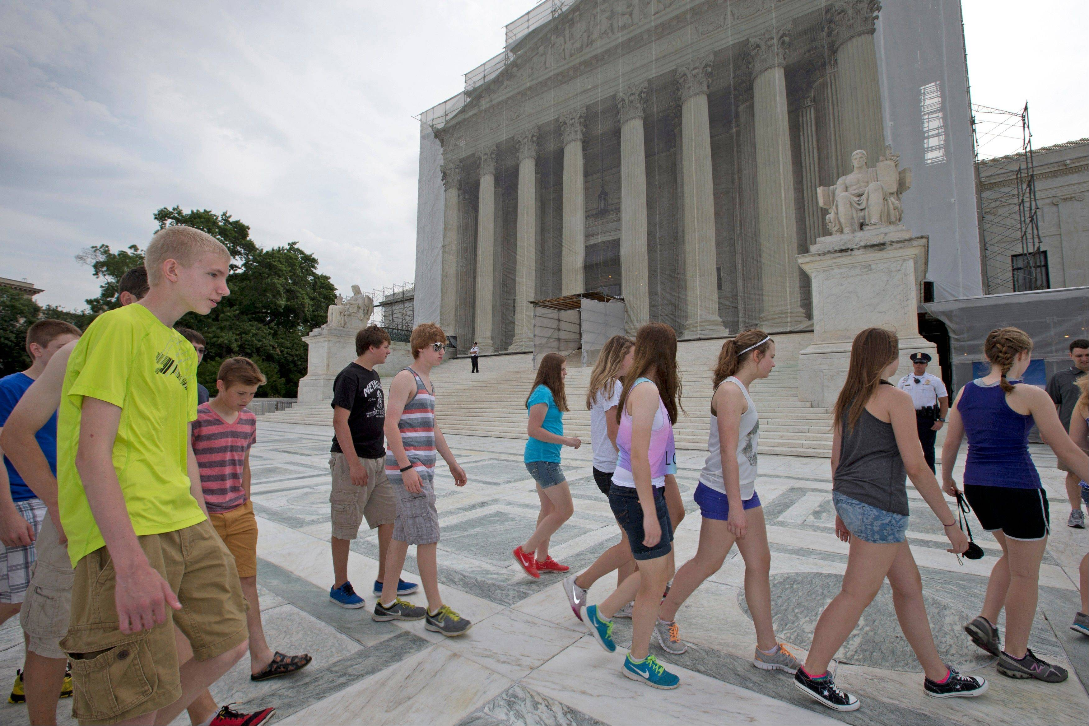 U.S. History students from Austin (Minn.) High School visit the Supreme Court in Washington Monday in anticipation of decisions being announced. In one of those decisions, the justices said deals between pharmaceutical corporations and their generic drug competitors can sometimes be illegal and therefore can be challenged in court.