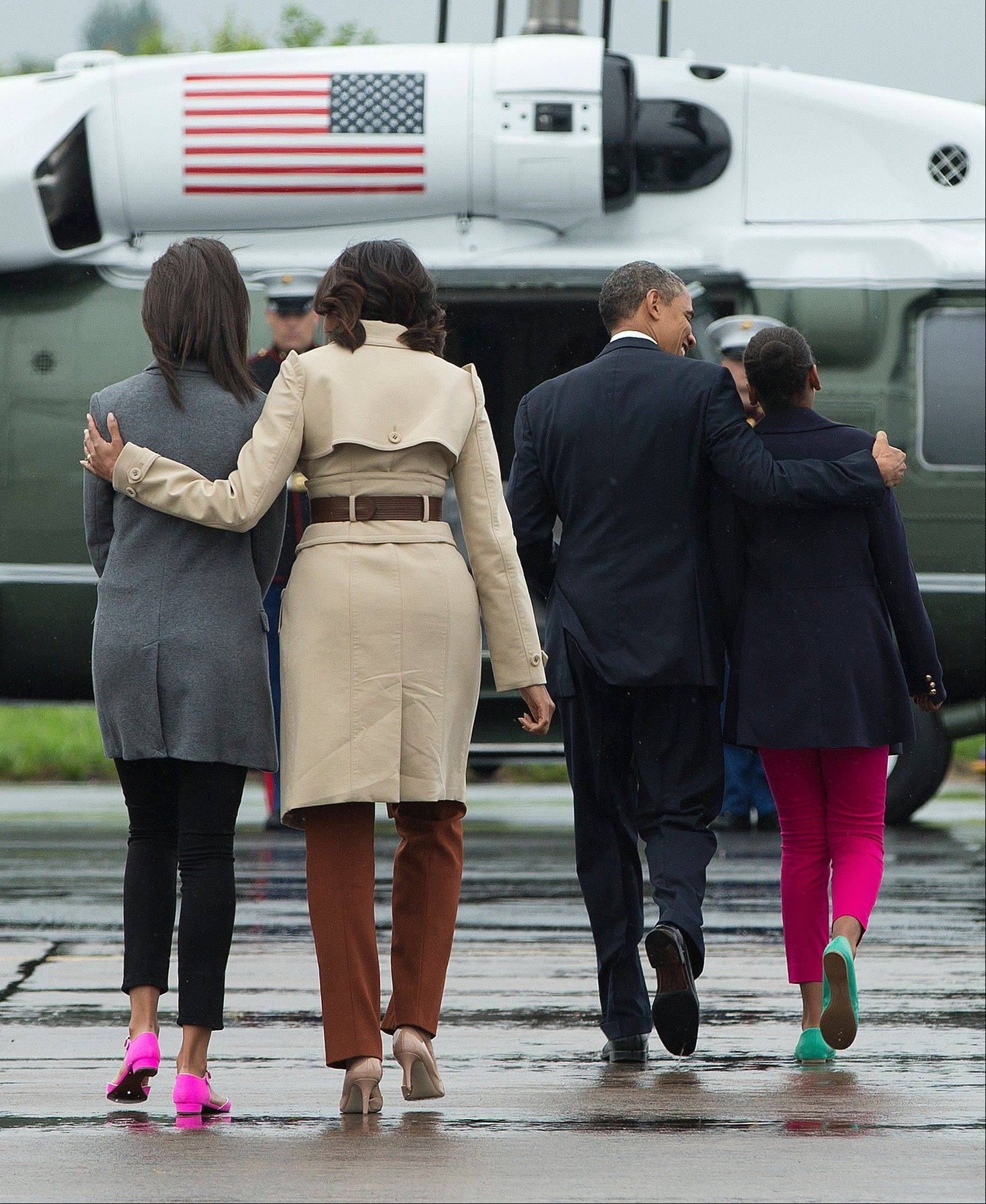 President Barack Obama, third from left, arrives in Belfast, Northern Ireland, with, from left, daughter Malia, first lady Michelle Obama, and daughter Sasha on Monday. Obama is attending the G-8 summit in Enniskillen, Northern Ireland.