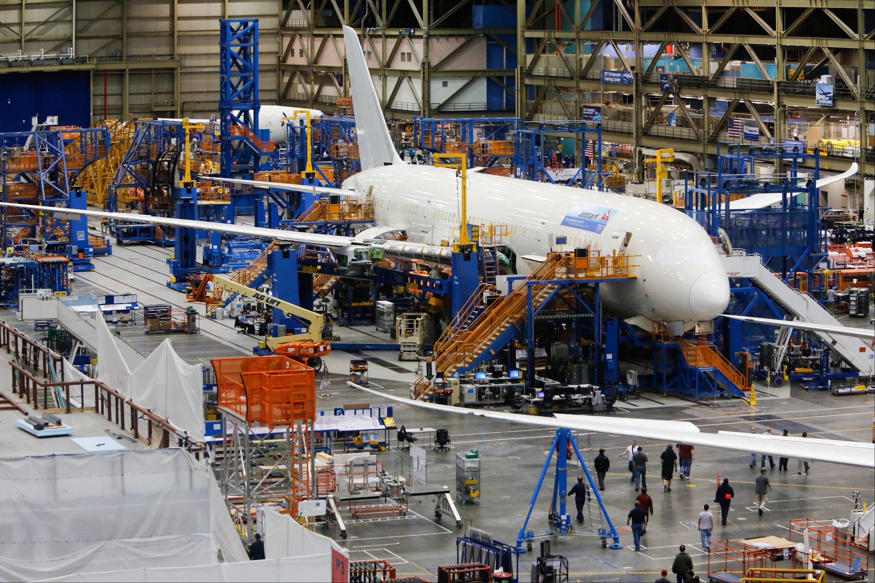 Workers assemble a Boeing Co. 787 Dreamliner airplane at the Boeing Everett Factory in Everett, Washington, U.S.