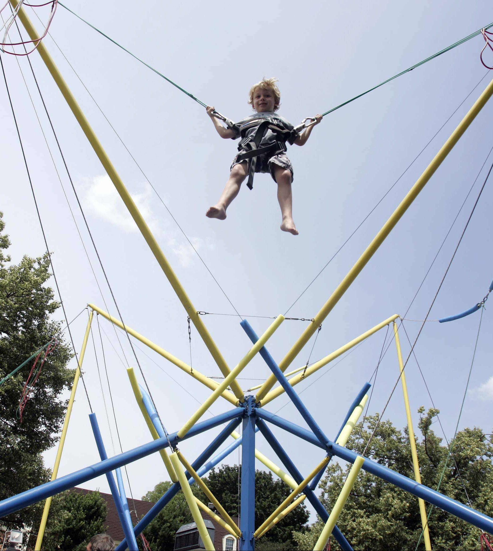 Four-year-old Cole Steben of Geneva gets a bird's-eye view of Swedish Days at last year's festival.