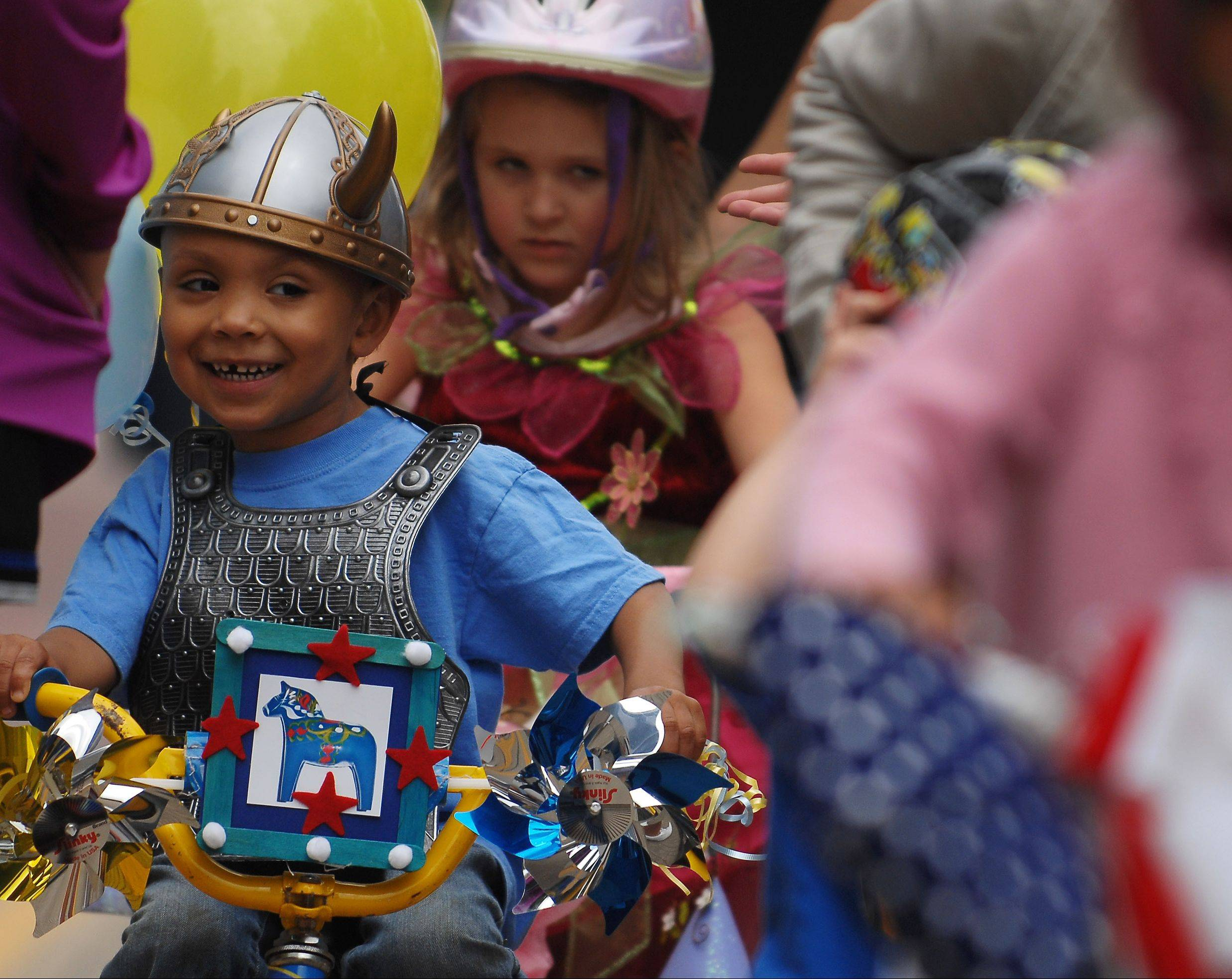Dontre McClose, 4, of Geneva smiles his way along Third Street during the kids parade at Swedish Days in Geneva. For a full schedule of events, see Page 2.