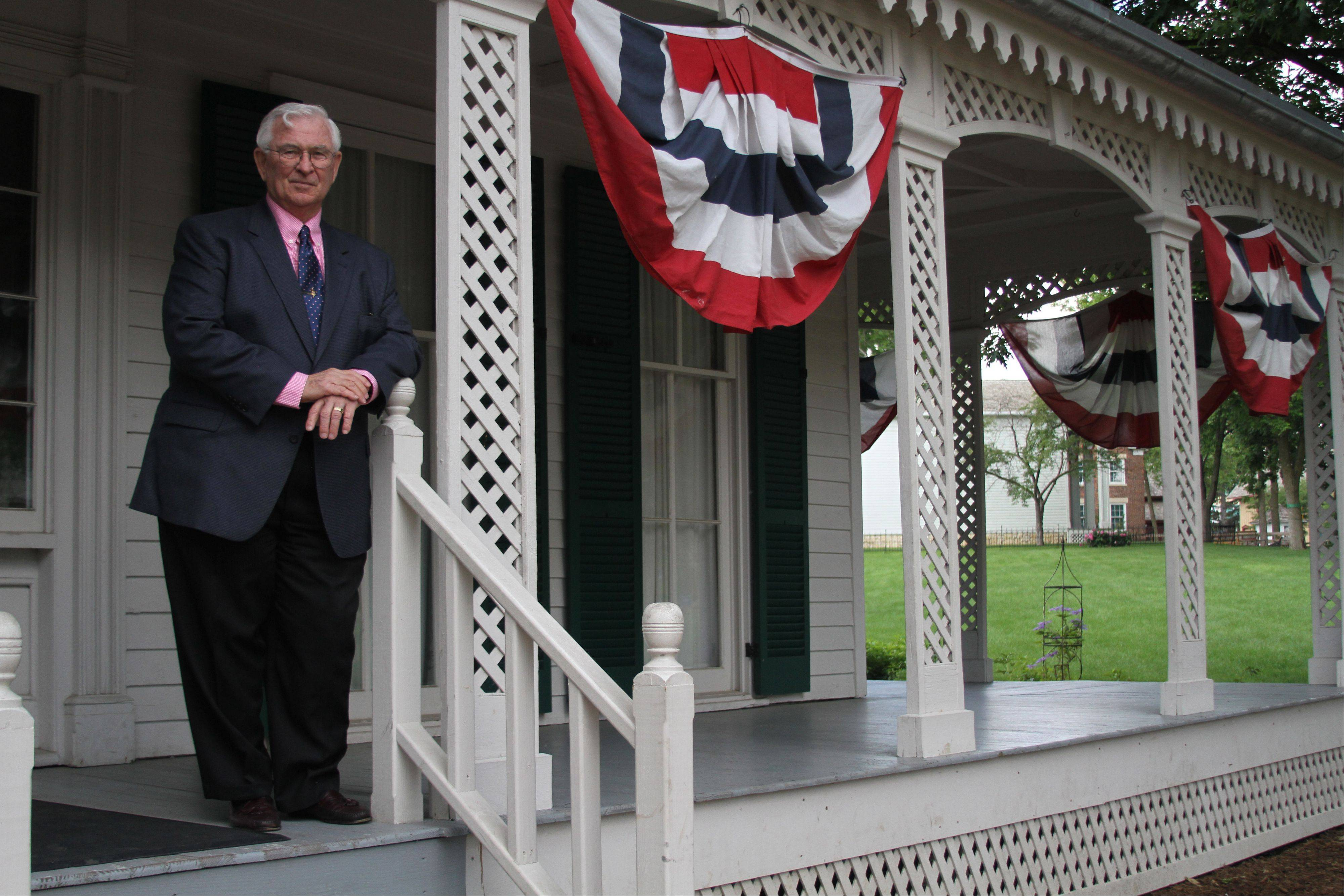 Mike Krol, a 28-year Naperville resident, is enthusiastic about the city's history. The Paw Paw Post Office is his favorite building at Naper Settlement.