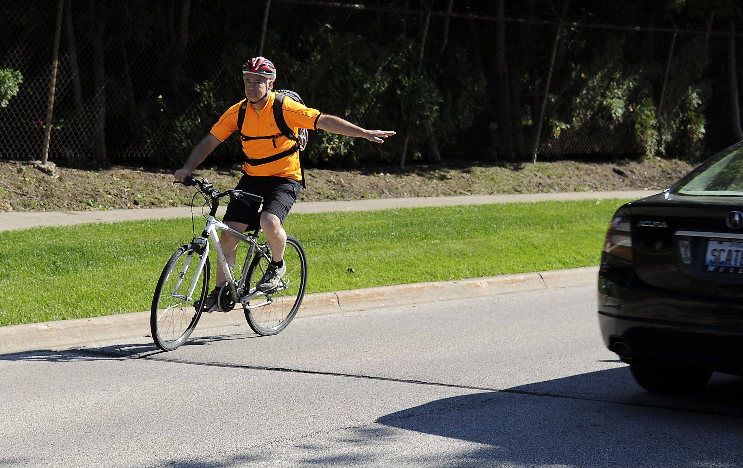 Buffalo Grove Village Planner Bob Pfeil signals left as he turns onto Checker Road en route from village hall to home in Libertyville.