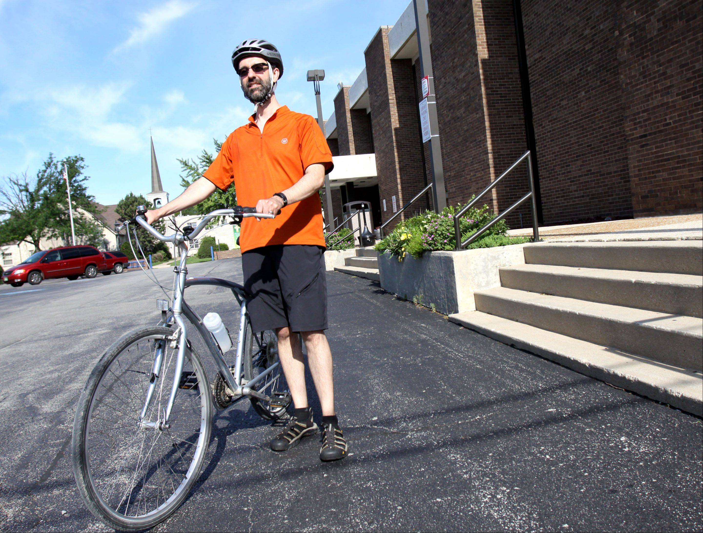 Villa Park librarian Sean Birmingham often bikes to work from Westmont using the Prairie Path to avoid busy streets.