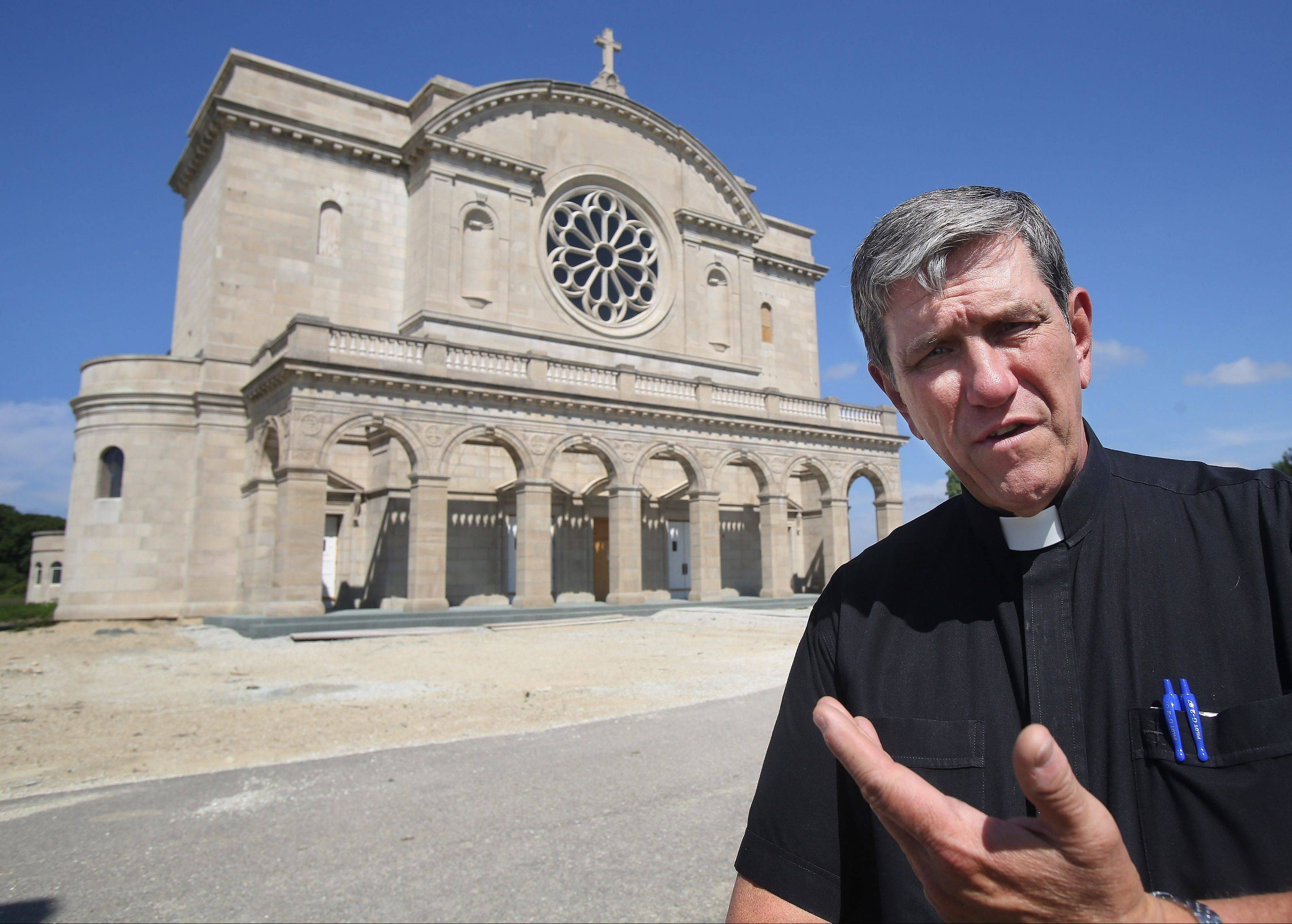 The Rev. John Jamnicky describes how the facade of the now demolished St. John of God Church in Chicago was reused as the face of the new St. Raphael the Archangel Catholic Church in Old Mill Creek.