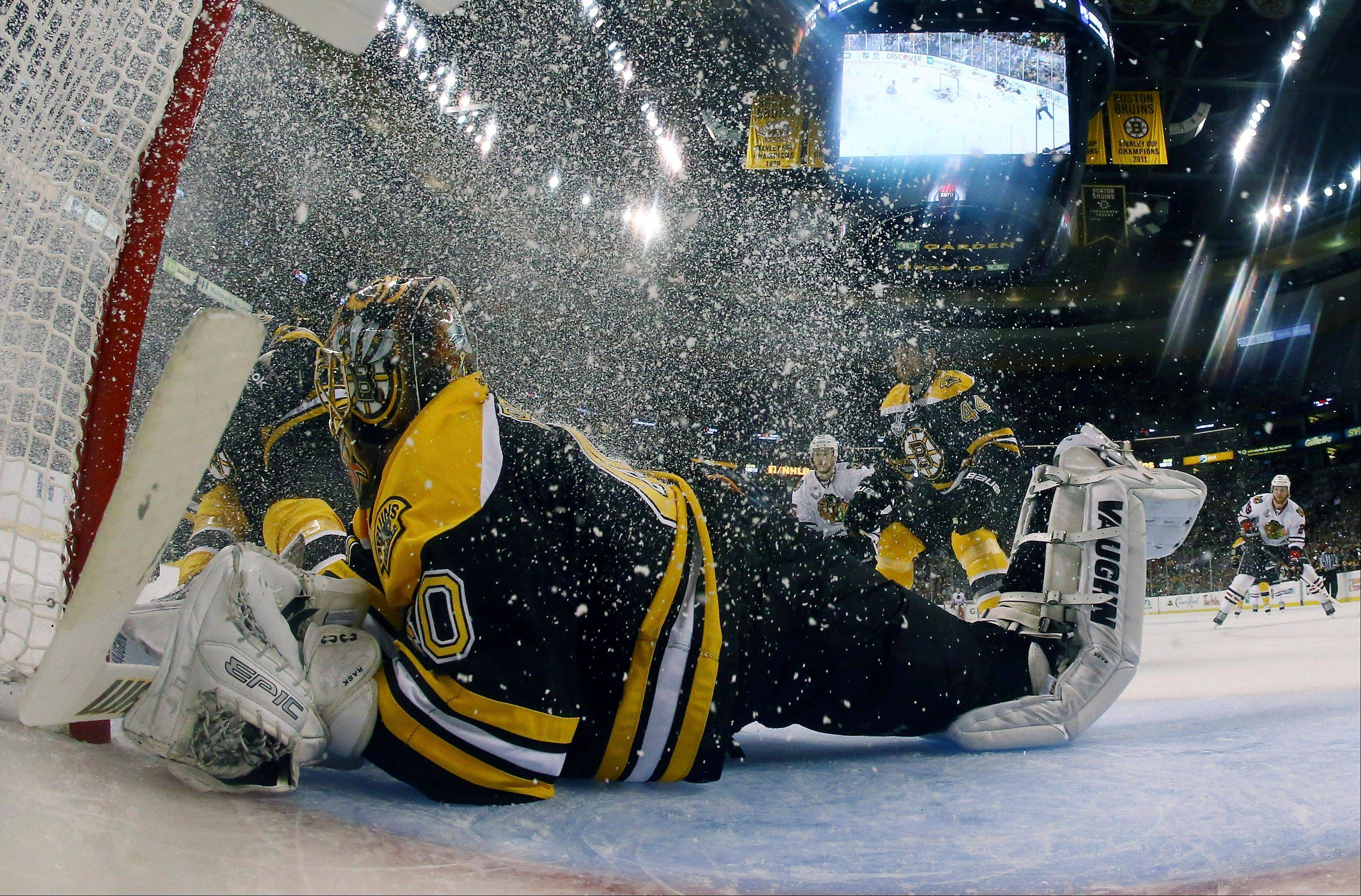 Boston Bruins goalie Tuukka Rask (40), of Finland, defends the net as ice crystals swirl around him during the second period in Game 3 of the NHL hockey Stanley Cup Finals against the Chicago Blackhawks.