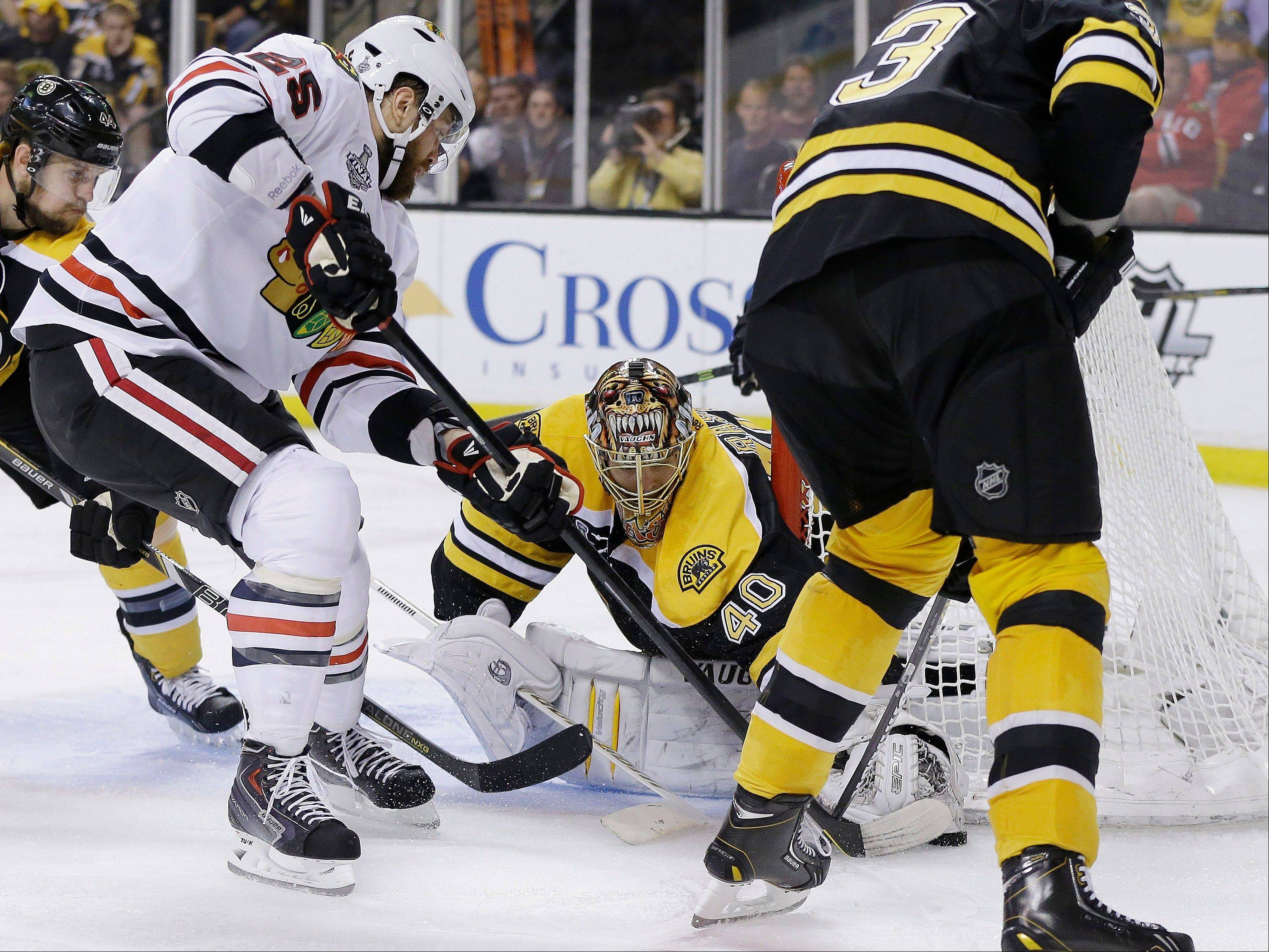 Boston Bruins goalie Tuukka Rask (40), of Finland, stops an attempt by Chicago Blackhawks left wing Viktor Stalberg (25), of Sweden, during the third period in Game 3 of the NHL hockey Stanley Cup Finals.