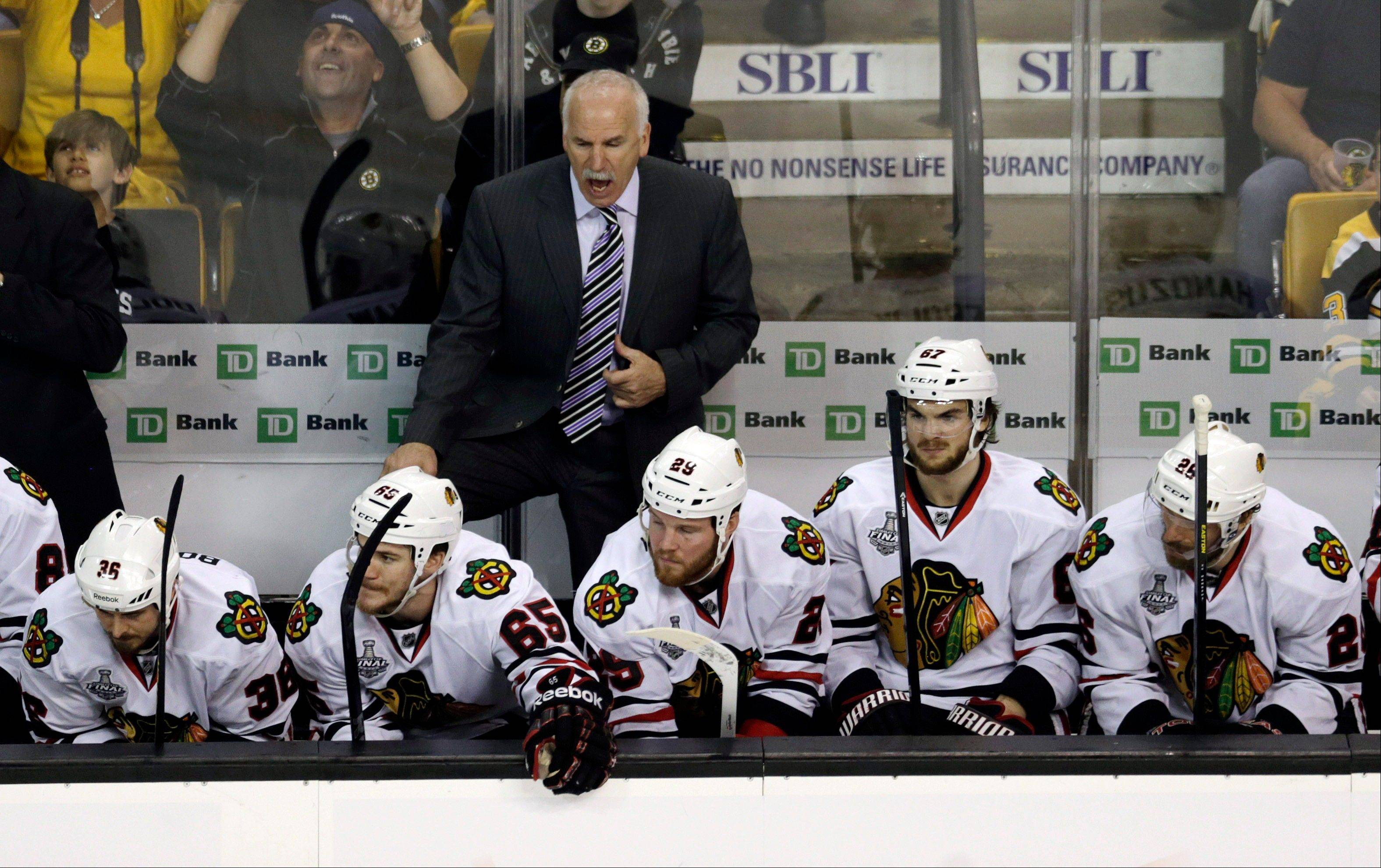 Blackhawks head coach Joel Quenneville shouts instructions to his team during the third period Monday against the Boston Bruins. Marian Hossa's absence forced Quenneville to radically alter his lines in Game 3.