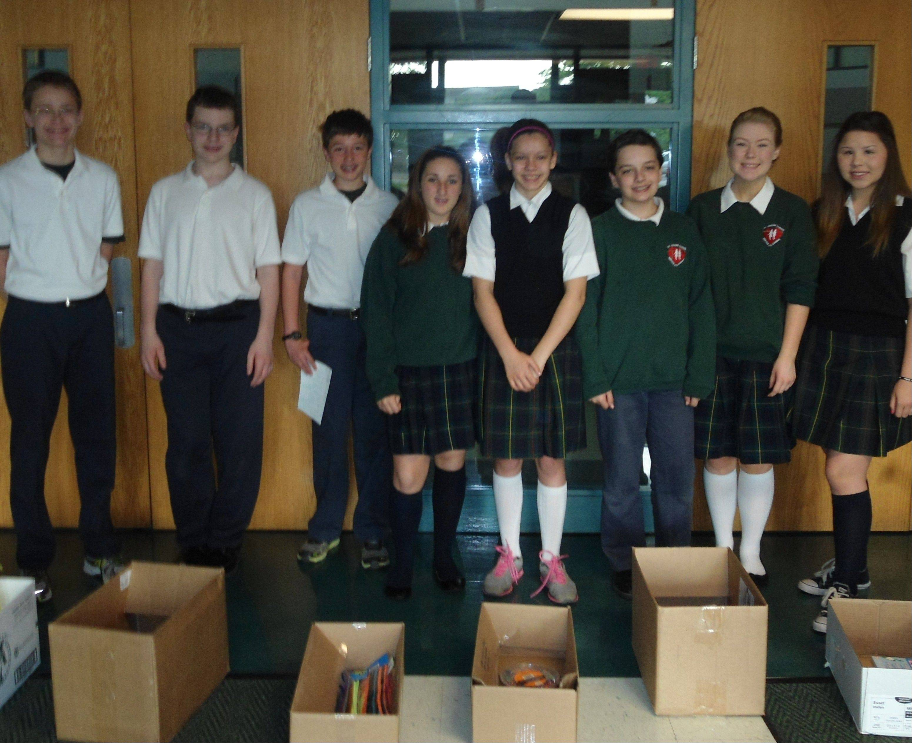 Leadership Academy members who collected craft supplies at St. Isidore School are, from left, Henry Breyne, Brendan Dunbar, Zach Barry, Isabella Sansone, Jenny Hauser, Donovan Maloney, Olivia Dorman and Jenna Jamieson. Not pictured: Marissa Testolin.
