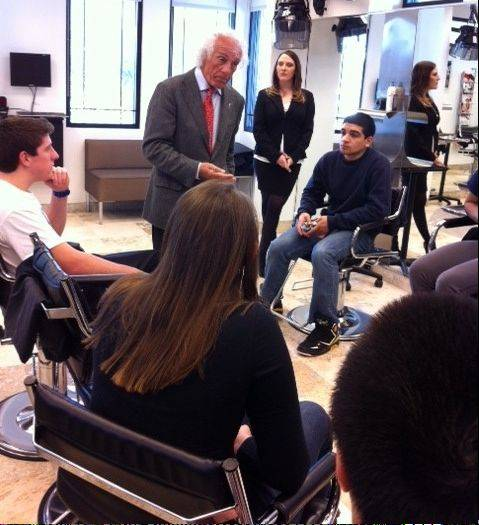YEA! students, including Yash Syal, seated center, listen to Mario Tricoci, famous hair stylist and entrepreneur, during a field trip.