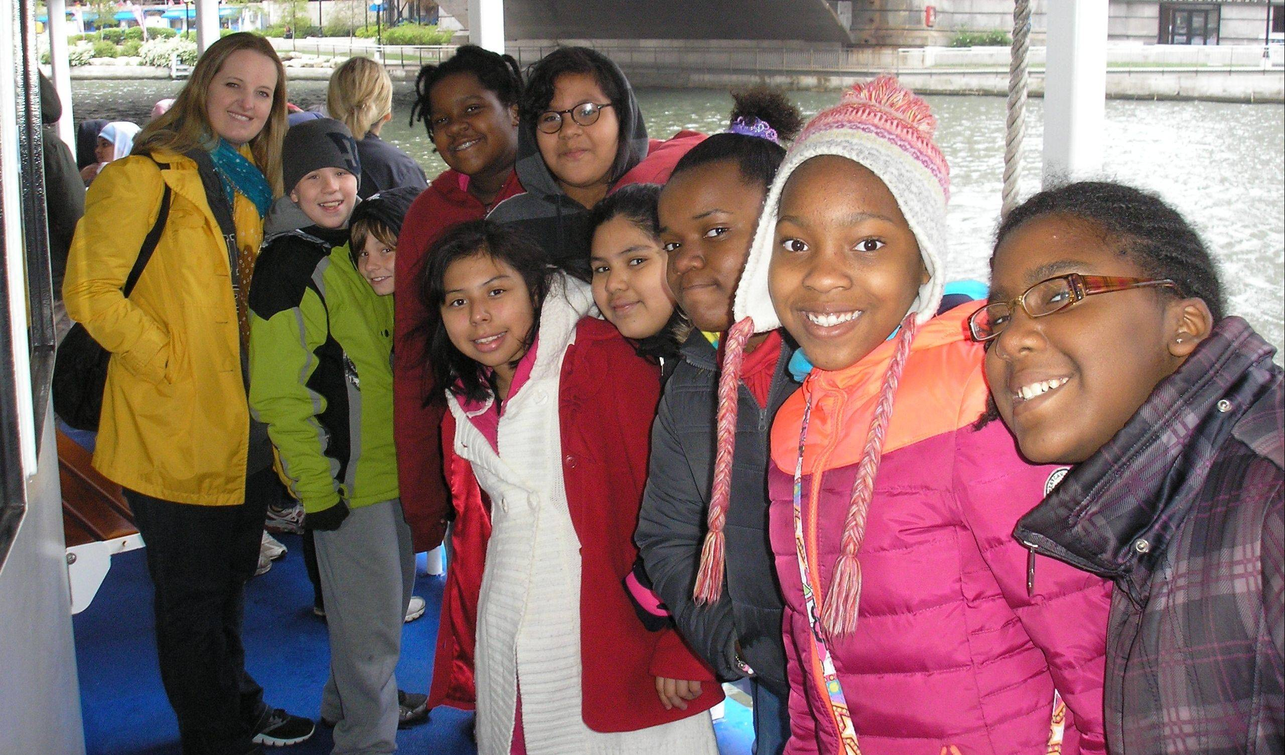 North teachers and fifth-grade students enjoyed an architectural cruise and an art museum tour in Chicago. This field trip culminated the cityscape projects they completed in art class. Pictured, from left, are: Leah Chestovich, Jakub Mitka, Peter Brozda (peeking head), Emily Glover, Jazmin Montesinos, Amarys Santos Cruz, Angeline Velazquez, Valencia Stansberry, Aaja Bass and Brianna Williams.