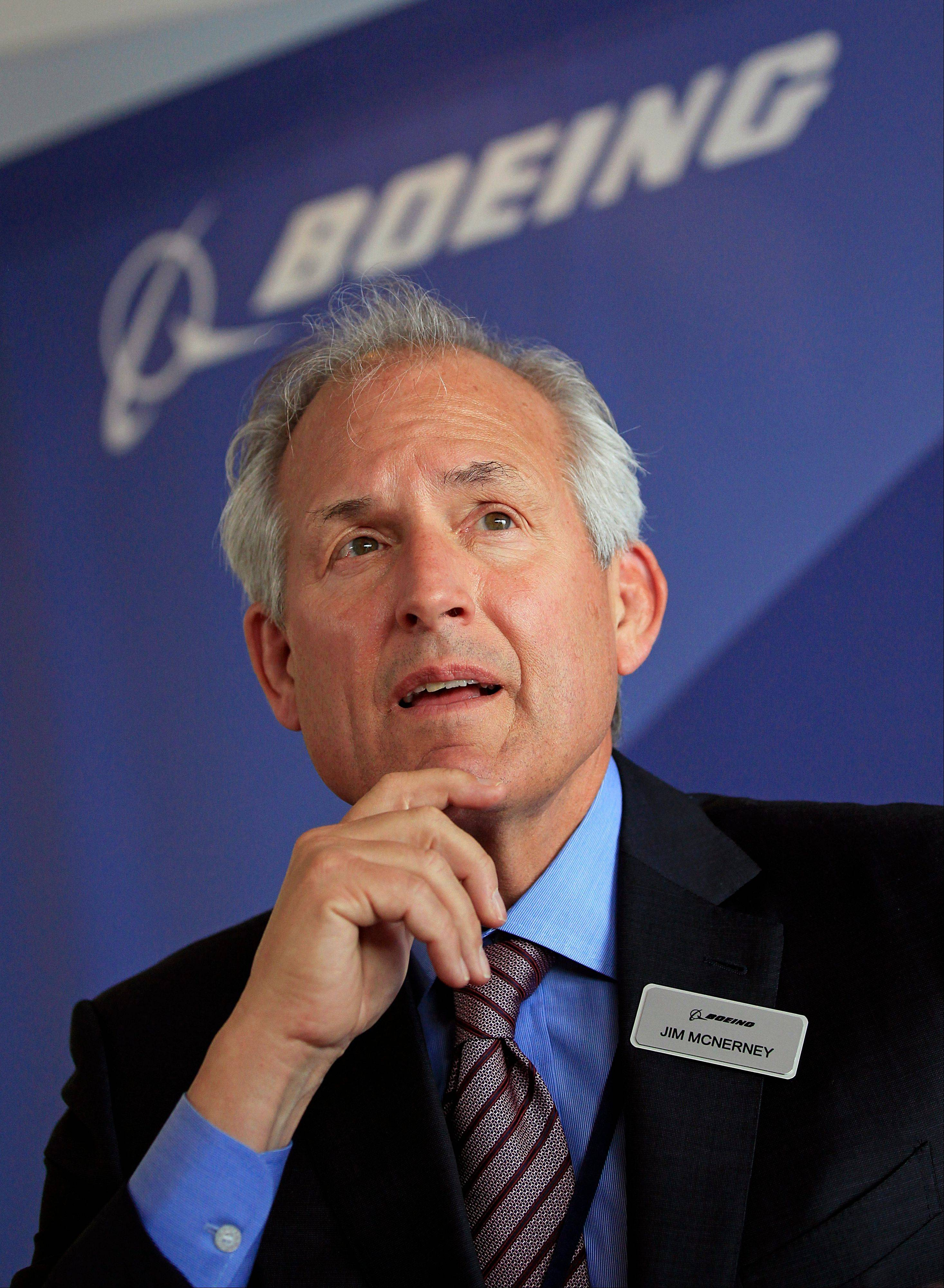 Boeing Company chairman and chief executive officer Jim McNerney speaks at a press conference at the Paris Air Show Tuesday. Boeing is starting work on a stretched-out version of its popular 787 Dreamliner jet, in the hope of reigniting interest in the aircraft after battery-related problems.