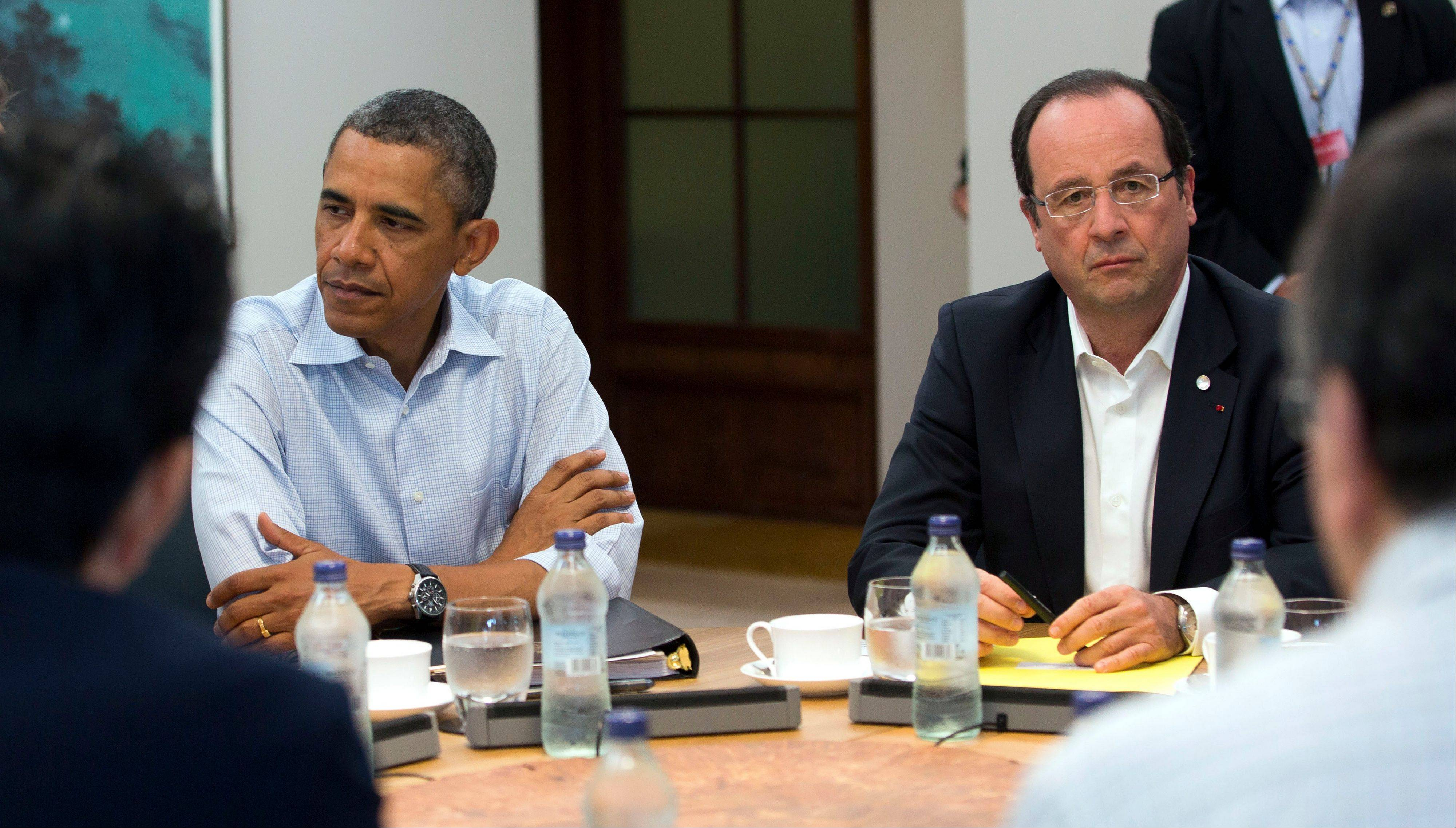 President Barack Obama and French President Francois Hollande attend a round table meeting of G-8 member countries at the G-8 Summit at the Lough Erne golf resort in Enniskillen, Northern Ireland, Tuesday.