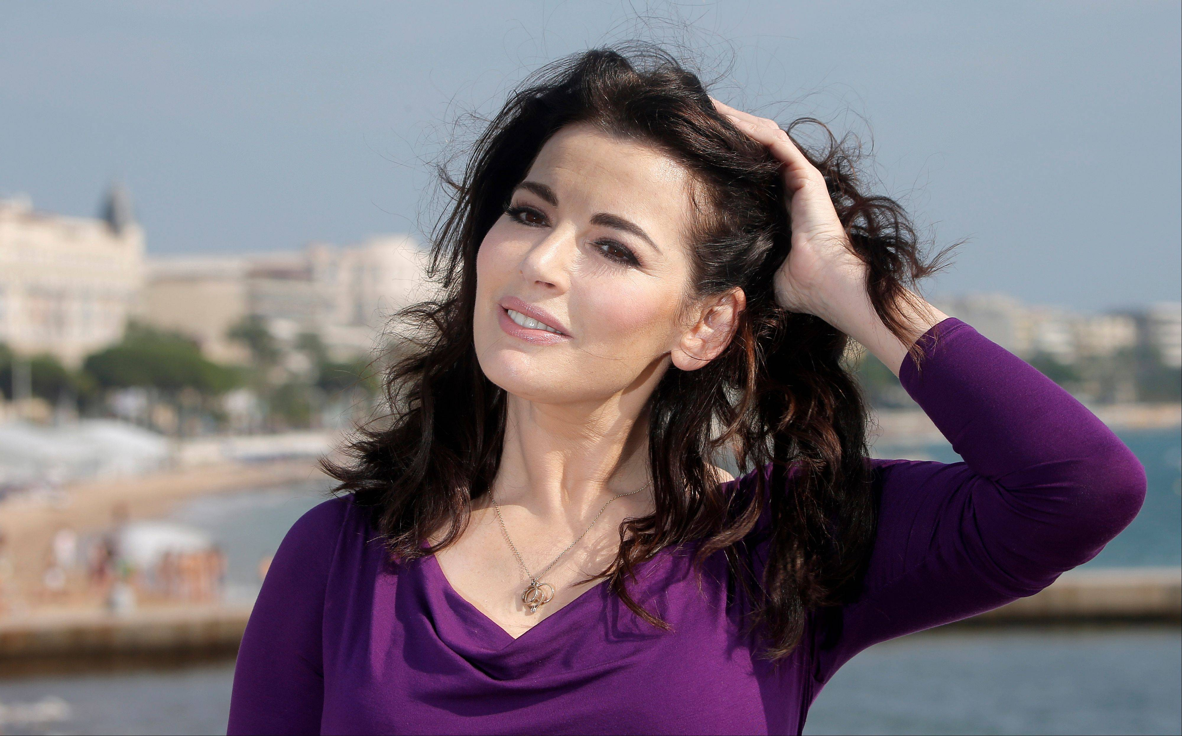 English food writer, journalist and broadcaster, Nigella Lawson. British police say they are investigating after a newspaper published photos of Nigella Lawson�s husband Charles Saatchi with his hands around the celebrity chef�s throat. The Sunday People newspaper ran pictures of what it said was the couple�s violent argument at a London restaurant on June 9, 2013.