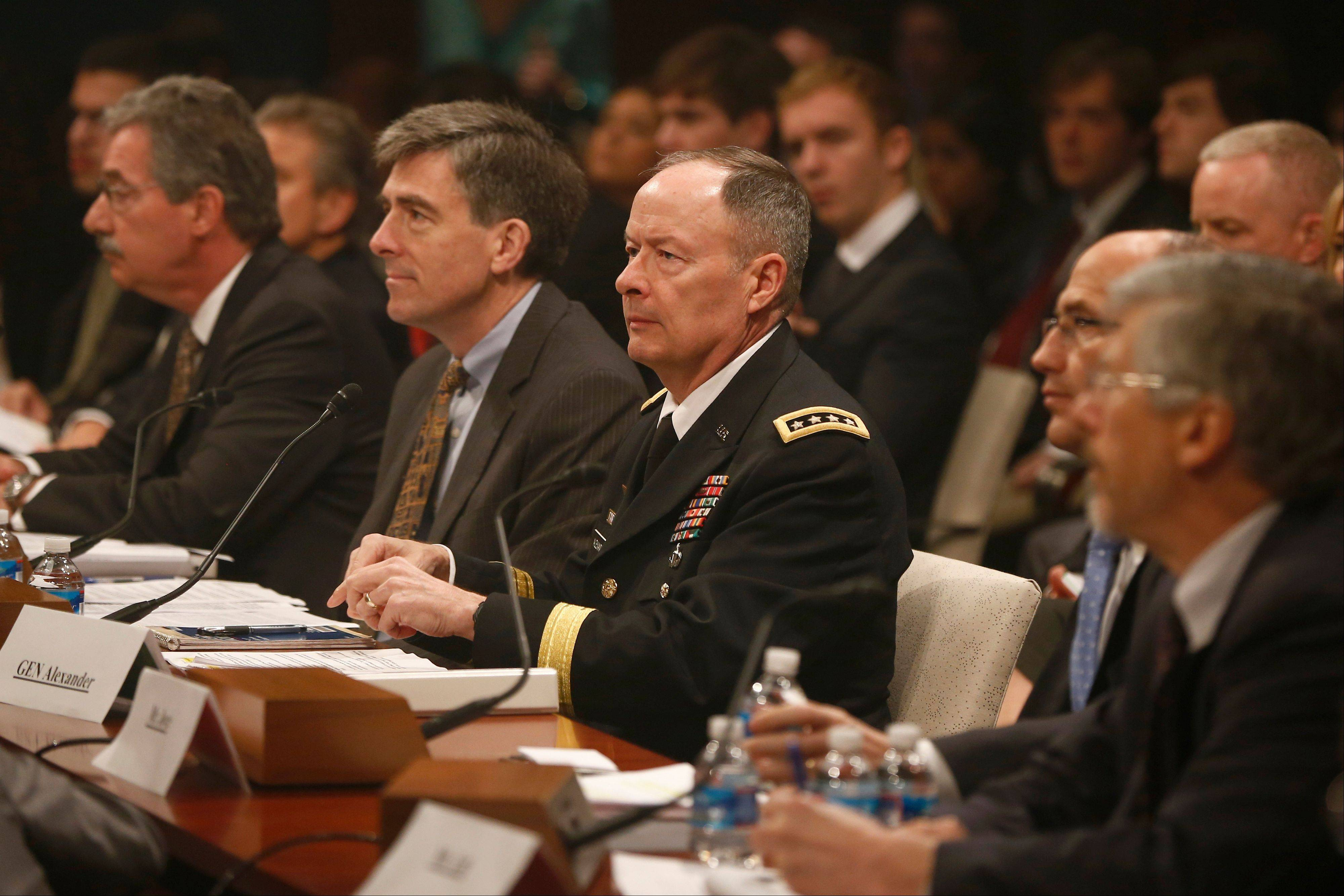 From left, Deputy Attorney General James Cole; National Security Agency (NSA) Deputy Director Chris Inglis; NSA Director Gen. Keith B. Alexander; Deputy FBI Director Sean Joyce; and Robert Litt, general counsel to the Office of the Director of National Intelligence; prepare to testify on Capitol Hill Tuesday before the House Intelligence Committee hearing regarding NSA surveillance.