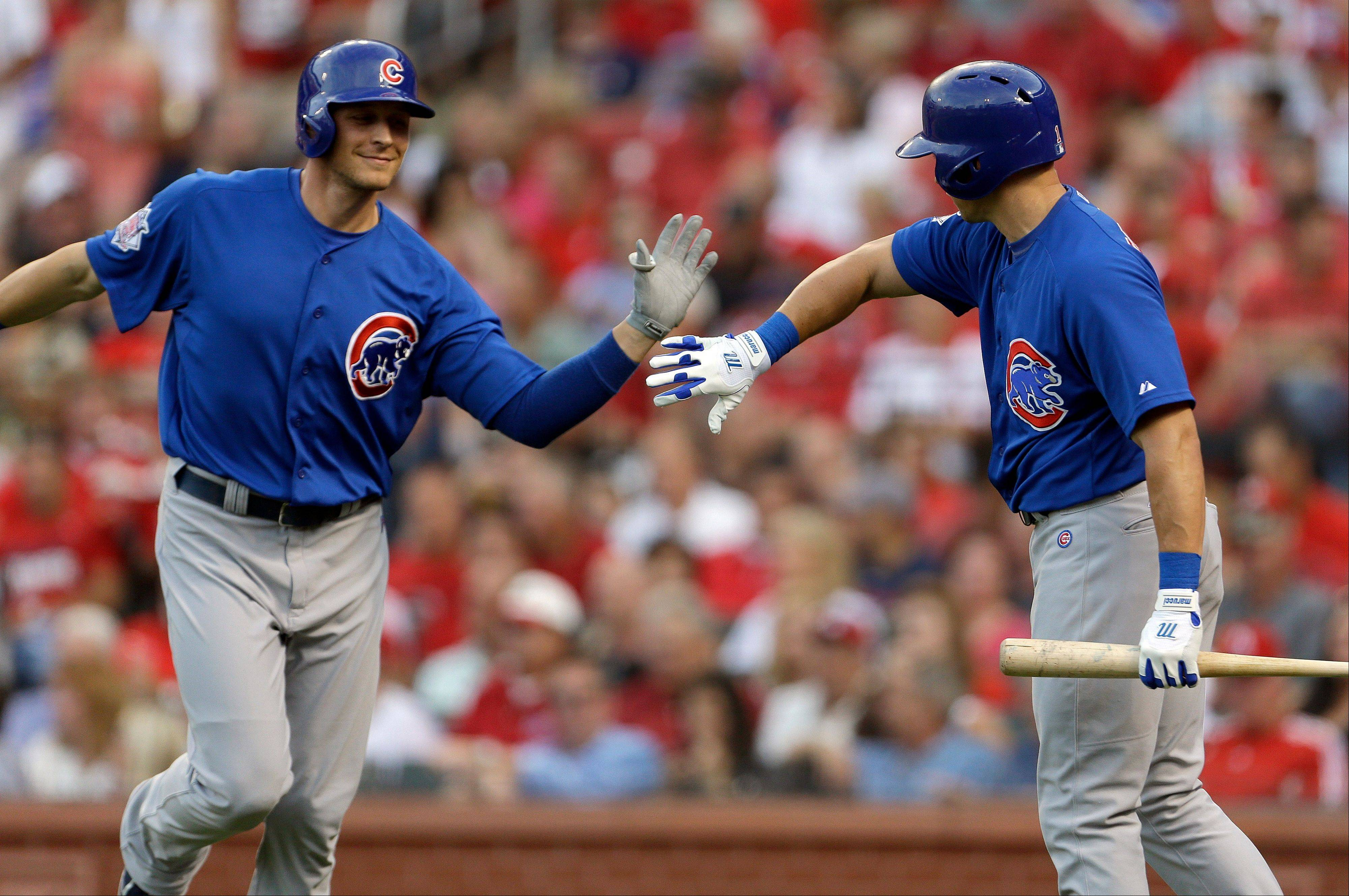 The Cubs� Ryan Sweeney, left, is congratulated by teammate Cody Ransom after hitting a two-run home run Tuesday night in St. Louis. The Cubs beat the St. Louis Cardinals 4-2.