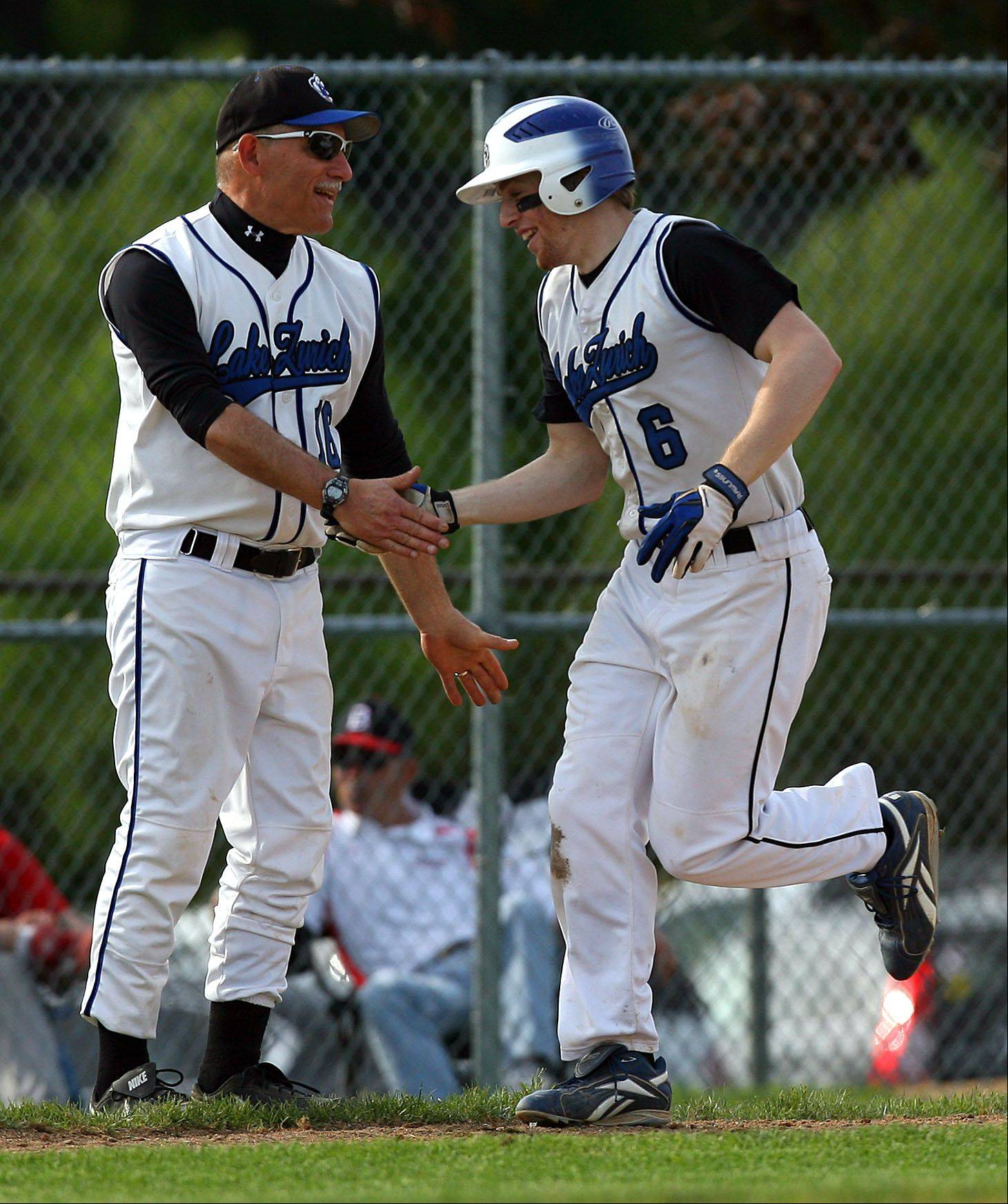 Lake Zurich head baseball coach Gary Simon, shown here congratulating Sean Eder after a home run in 2011, will not return for a 14th season with the Bears.