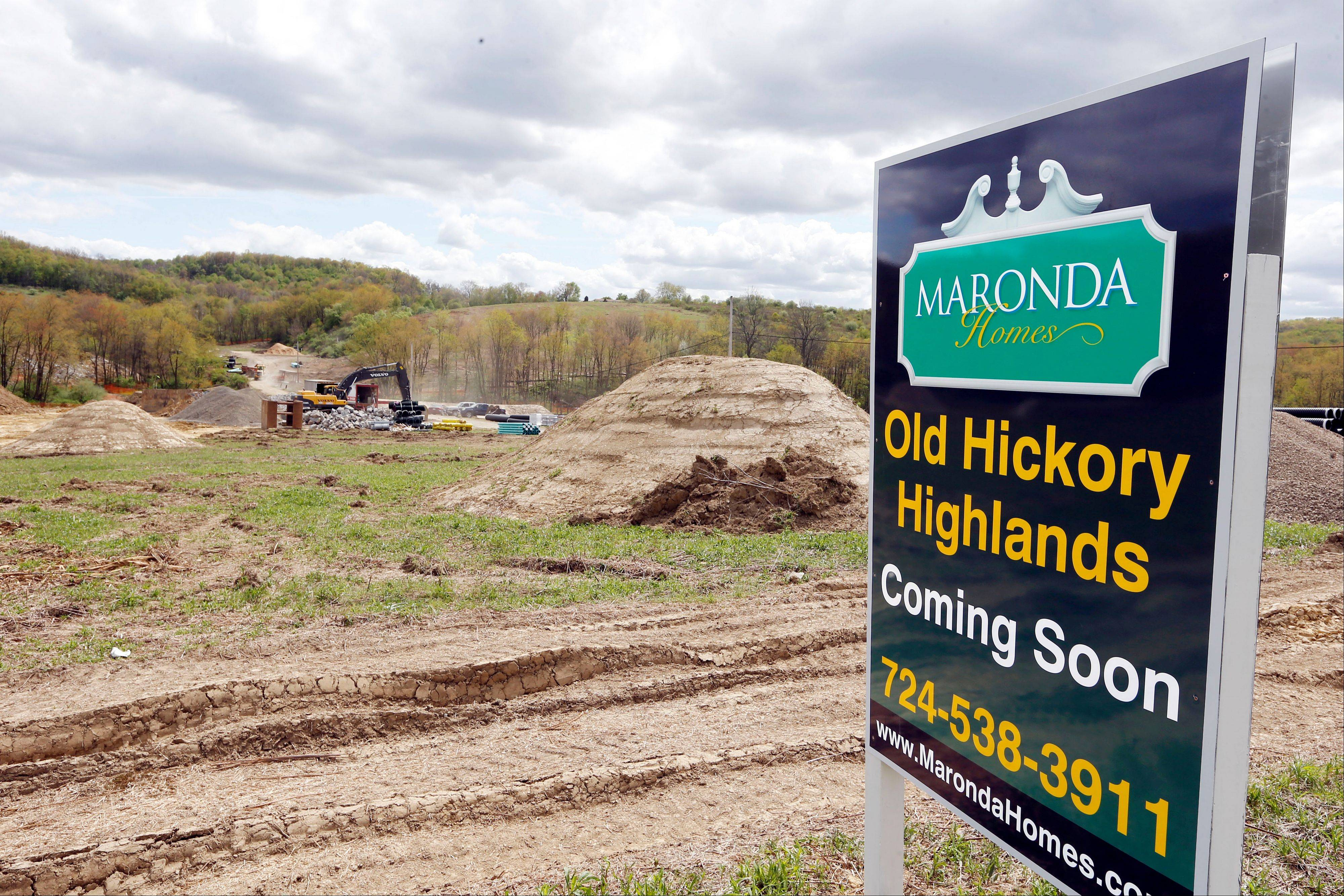 Construction is underway on the infrastructure of a multi-acre housing development in Zelienople, Pa. Builders stepped up home construction in May and applied for permits to build single-family homes at the fastest pace in five years.